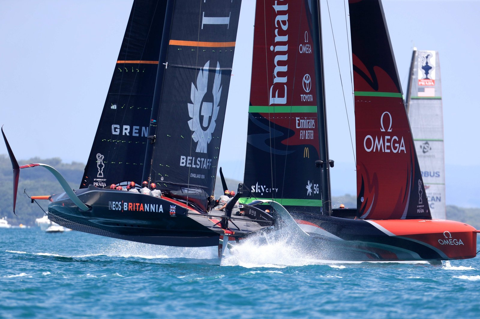 INEOS Team UK (L) competes against Emirates Team New Zealand during the race in Auckland, New Zealand, Dec. 20, 2020. (AFP PHOTO)