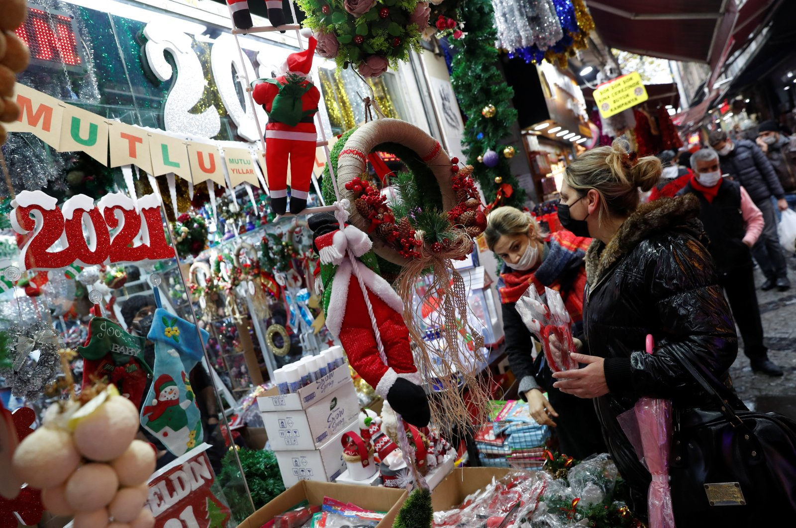 Women wearing protective face masks peruse a store selling Christmas and New Year ornaments, amid the spread of COVID-19, in Istanbul, Turkey, Dec. 16, 2020. (Reuters Photo)