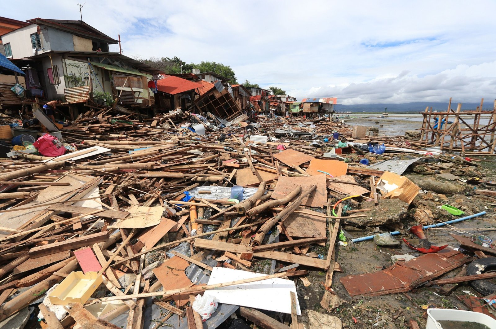 Houses destroyed in Tropical Depression Vicky in Lapu-Lapu City on Cebu Island, Philippines, Dec. 19, 2020. (AFP Photo)
