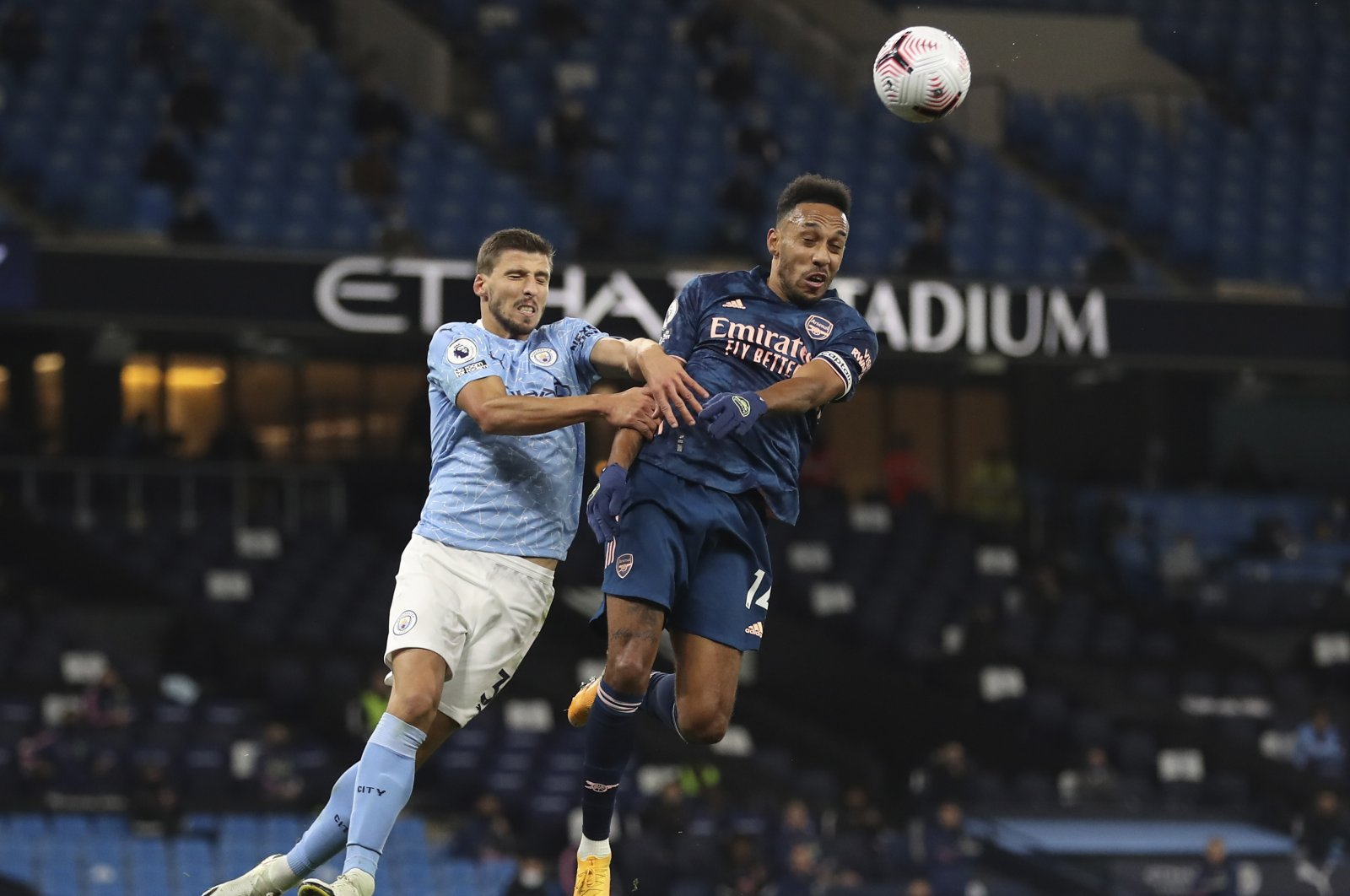 Manchester City's Ruben Dias (L) jumps for the ball with Arsenal's Pierre-Emerick Aubameyang during a Premier League match at the Etihad stadium in Manchester, England, Oct. 17, 2020. (AP Photo)