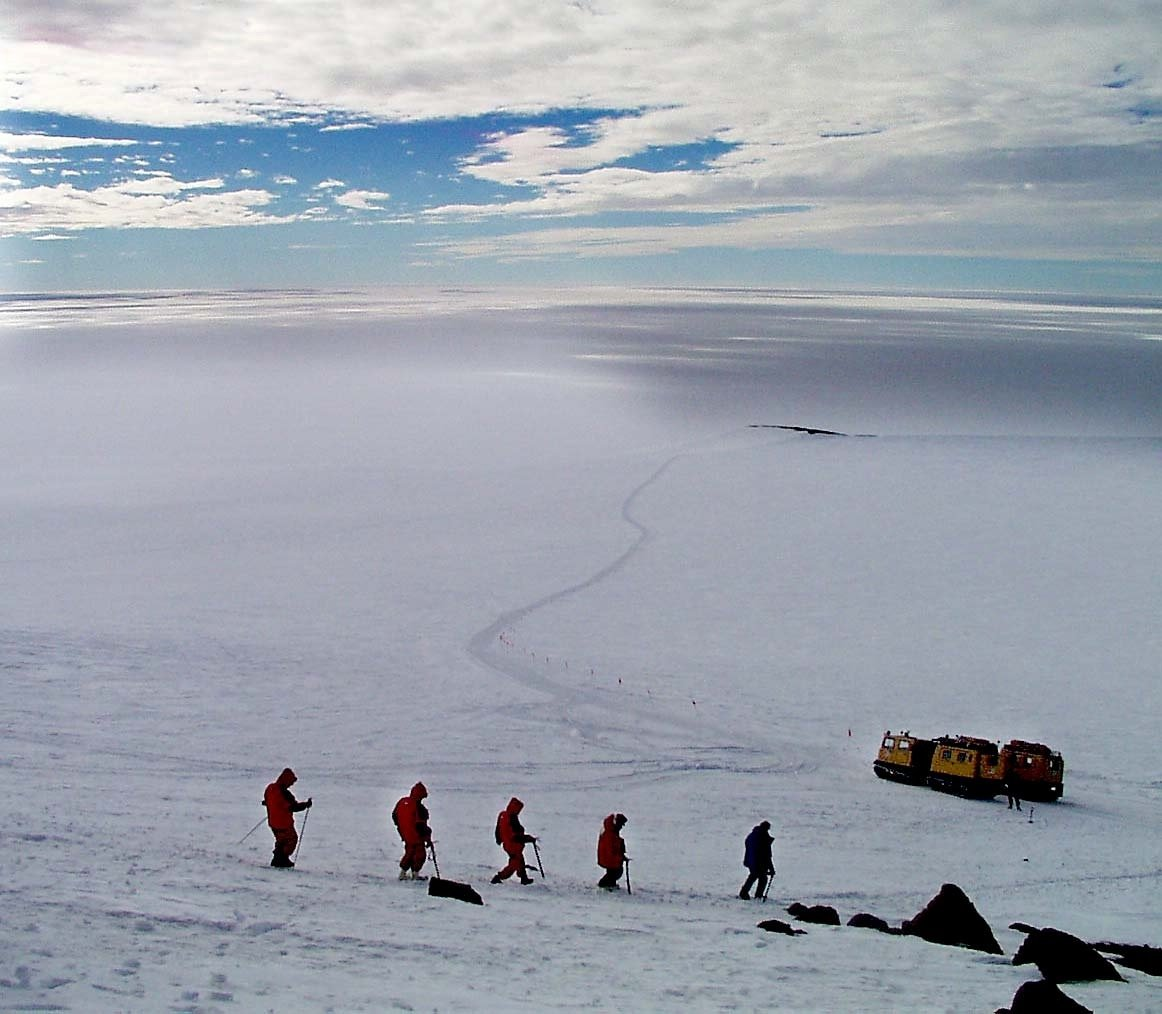With a sweeping view of the Ross Ice Shelf racing out in front of them, visiting ministers and ambassadors make their way back to the yellow tracked vehicles that carried them across the snow and ice surrounding Scott Base, Antarctica, Jan. 26, 1999. (AP Photo)