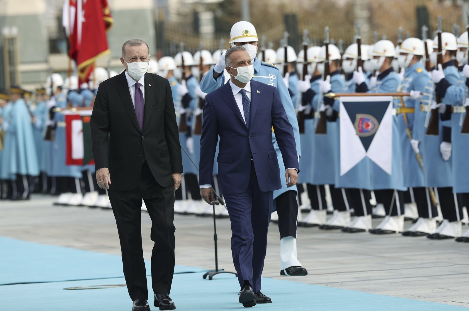 President Recep Tayyip Erdoğan walks with Iraqi Prime Minister Mustafa al-Kadhimi during a welcome ceremony at the Presidential Complex, capital Ankara, Turkey, Dec. 17, 2020. (AP Photo)