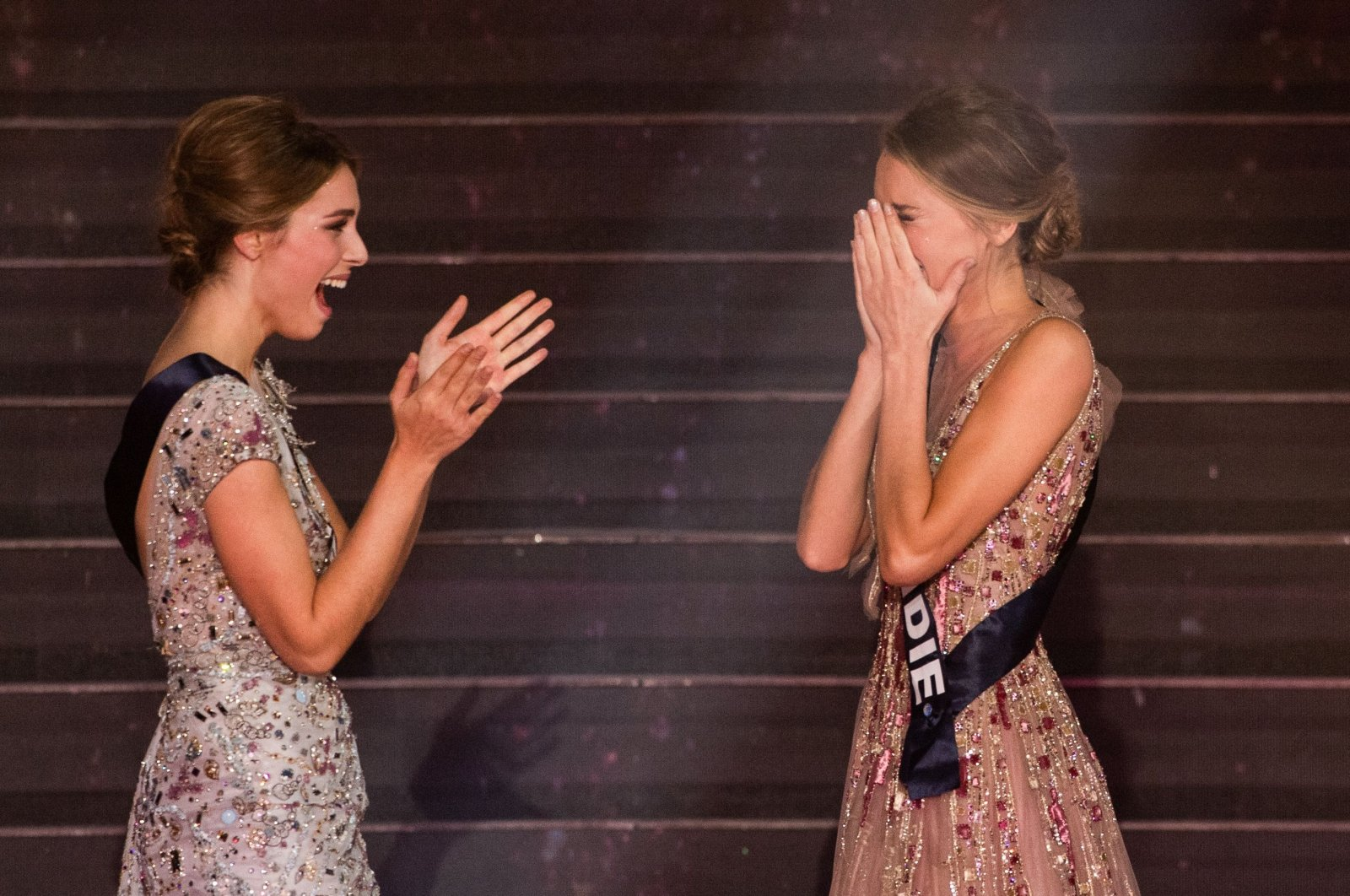 Newly elected Miss France 2021 Miss Normandie Amandine Petit (R) cries in front of Miss Provence April Benayoum at the end of the Miss France 2021 beauty contest at the Puy-du-Fou, in Les Epesses, western France, on Dec. 20, 2020. (AFP Photo)