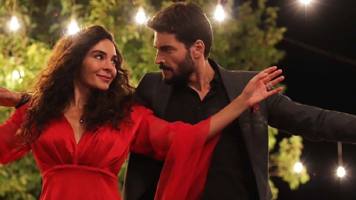 "Ebru Şahin as Reyyan (L) and Akın Akınözü as Miran in a scene from ""Hercai."""