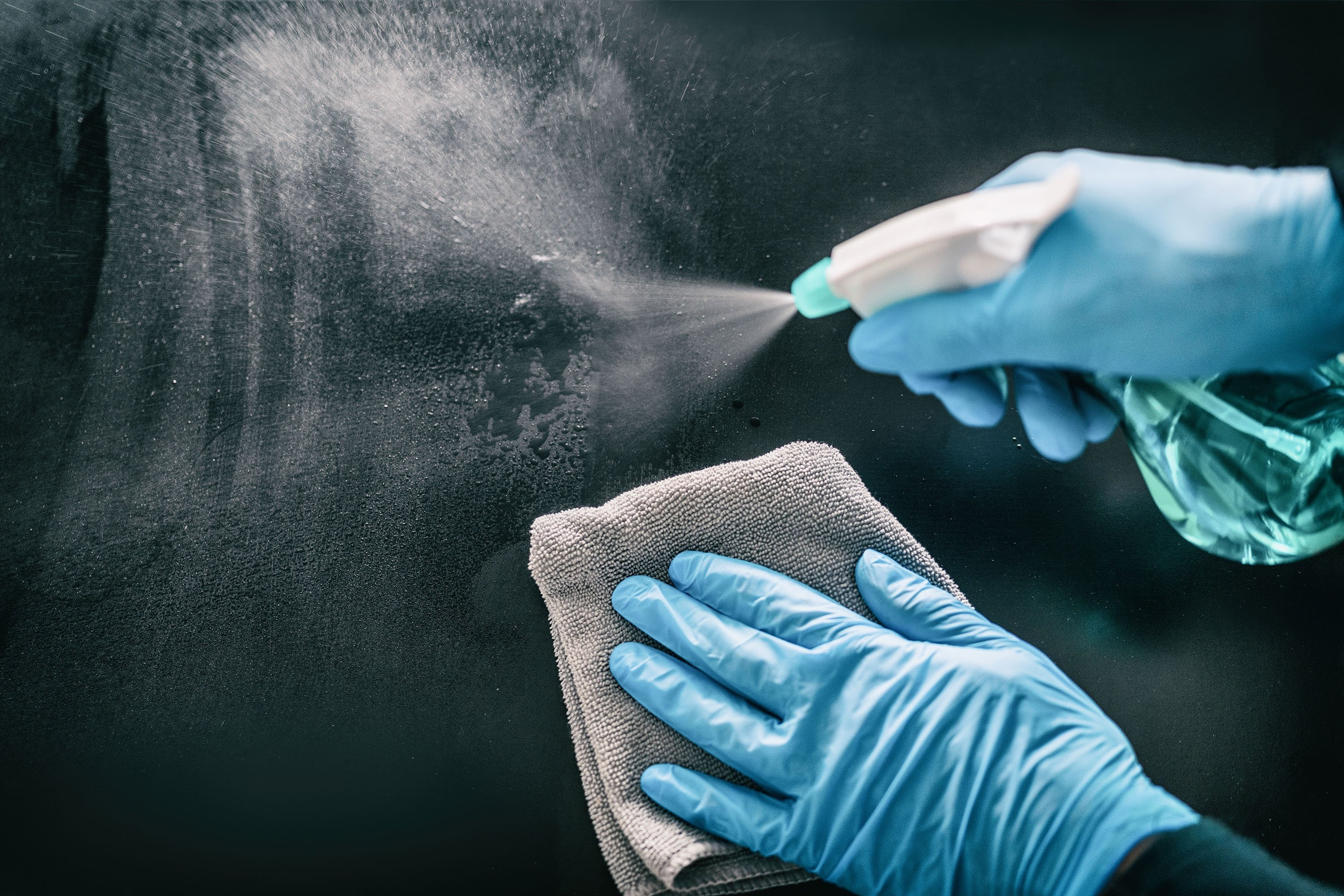 Wear gloves while cleaning to save yourself from too much contact with drying chemicals. (Shutterstock Photo)
