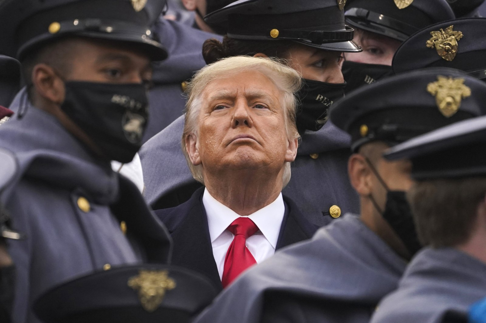 Surrounded by U.S. Army cadets, President Donald Trump watches the first half of the 121st Army-Navy Football Game in Michie Stadium at the United States Military Academy, in West Point, New York, U.S., Dec. 12, 2020. (AP Photo)