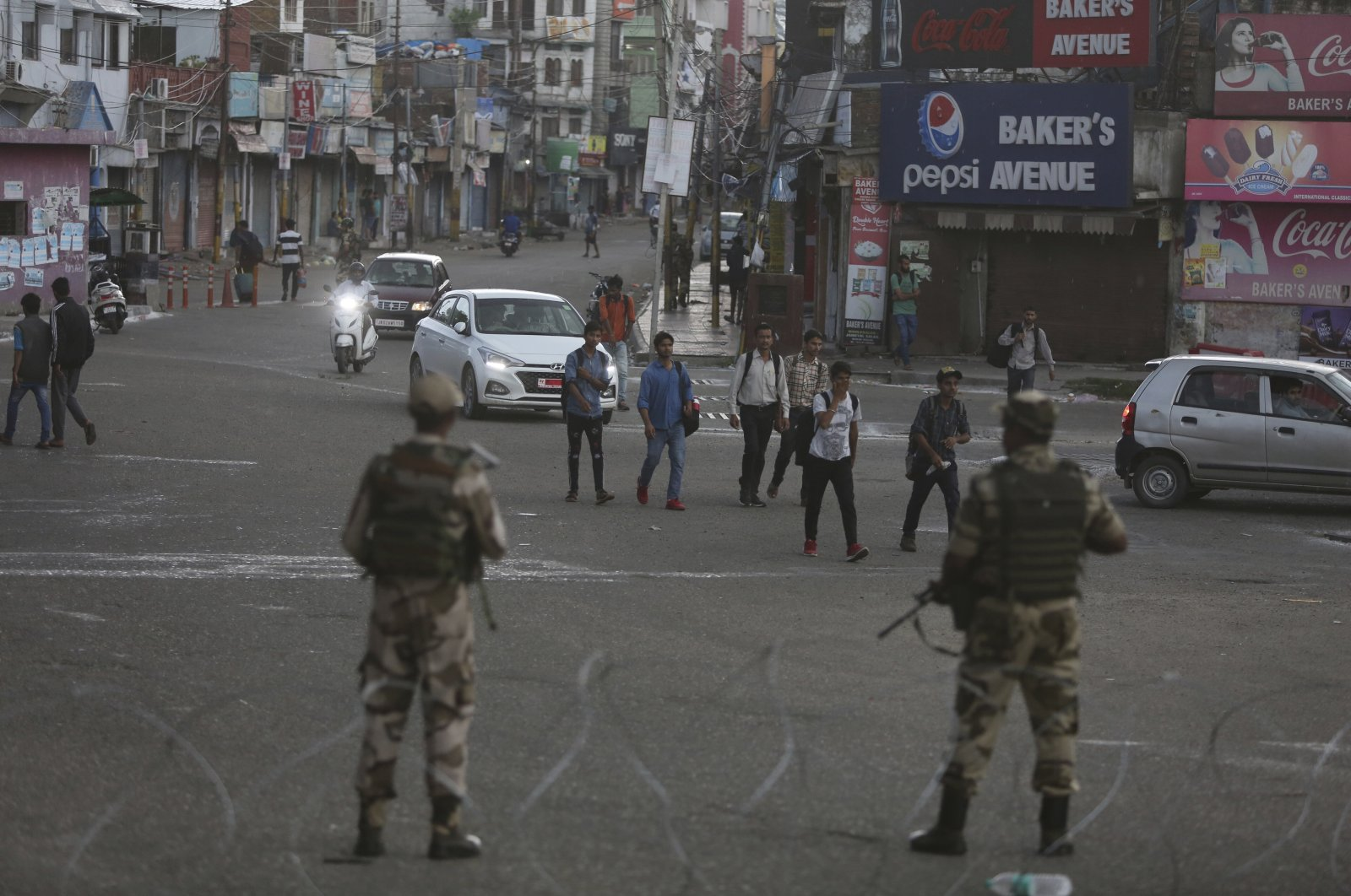Indian paramilitary soldiers stand guard during curfew-like restrictions in Jammu, India, Aug. 5, 2019. (AP Photo)