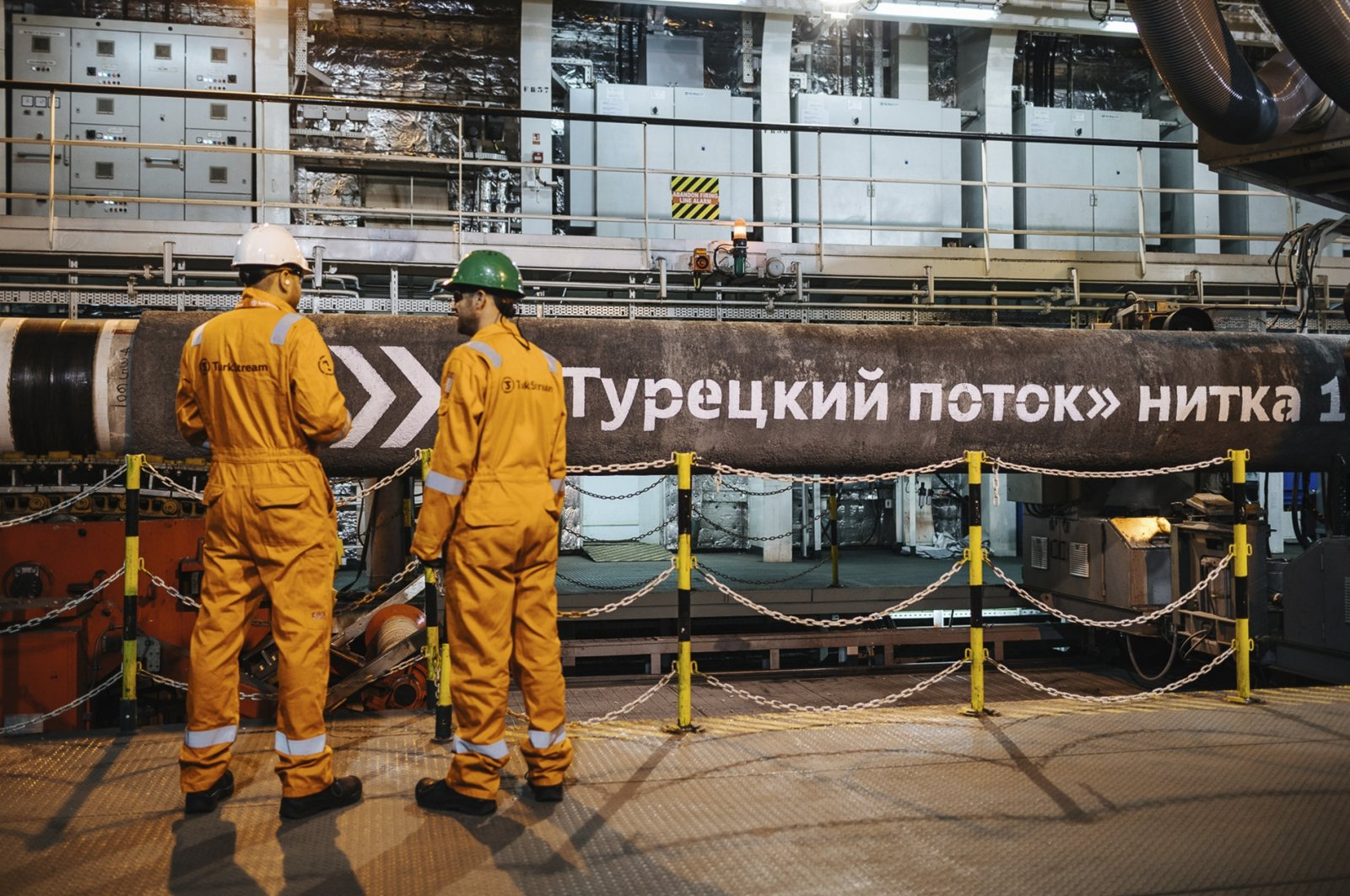This file photo shows workers in front of pipes to be laid on the Black Sea seabed by the vessel Pioneering Spirit as part of the TurkStream gas pipeline project, Feb. 5, 2018. (AA Photo)