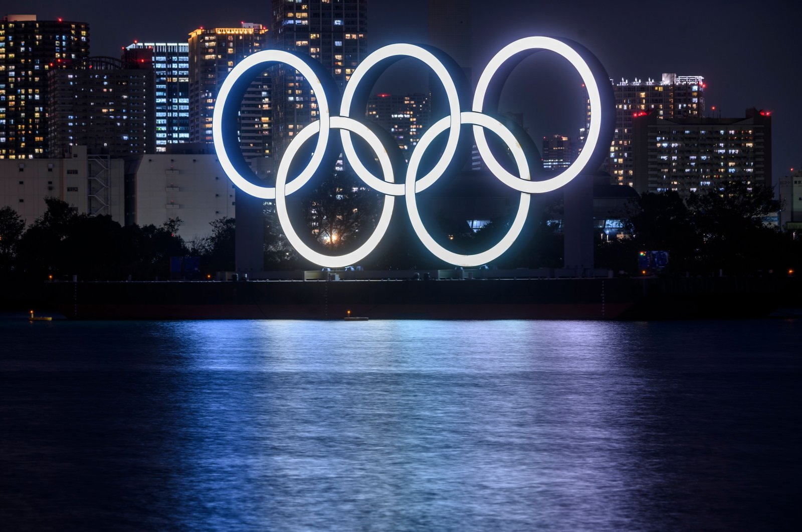 The giant Olympic rings illuminated on display at the waterfront area at Odaiba Marine Park in Tokyo, Japan, Dec. 1, 2020. (AFP Photo)