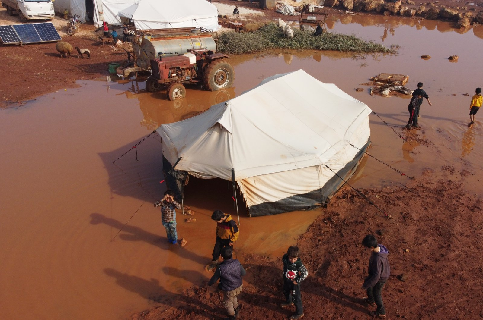 Tents that were flooded by heavy rains are seen in Kafarouk camp in northwestern Syria's Idlib province, Dec. 19, 2020. (AA Photo)
