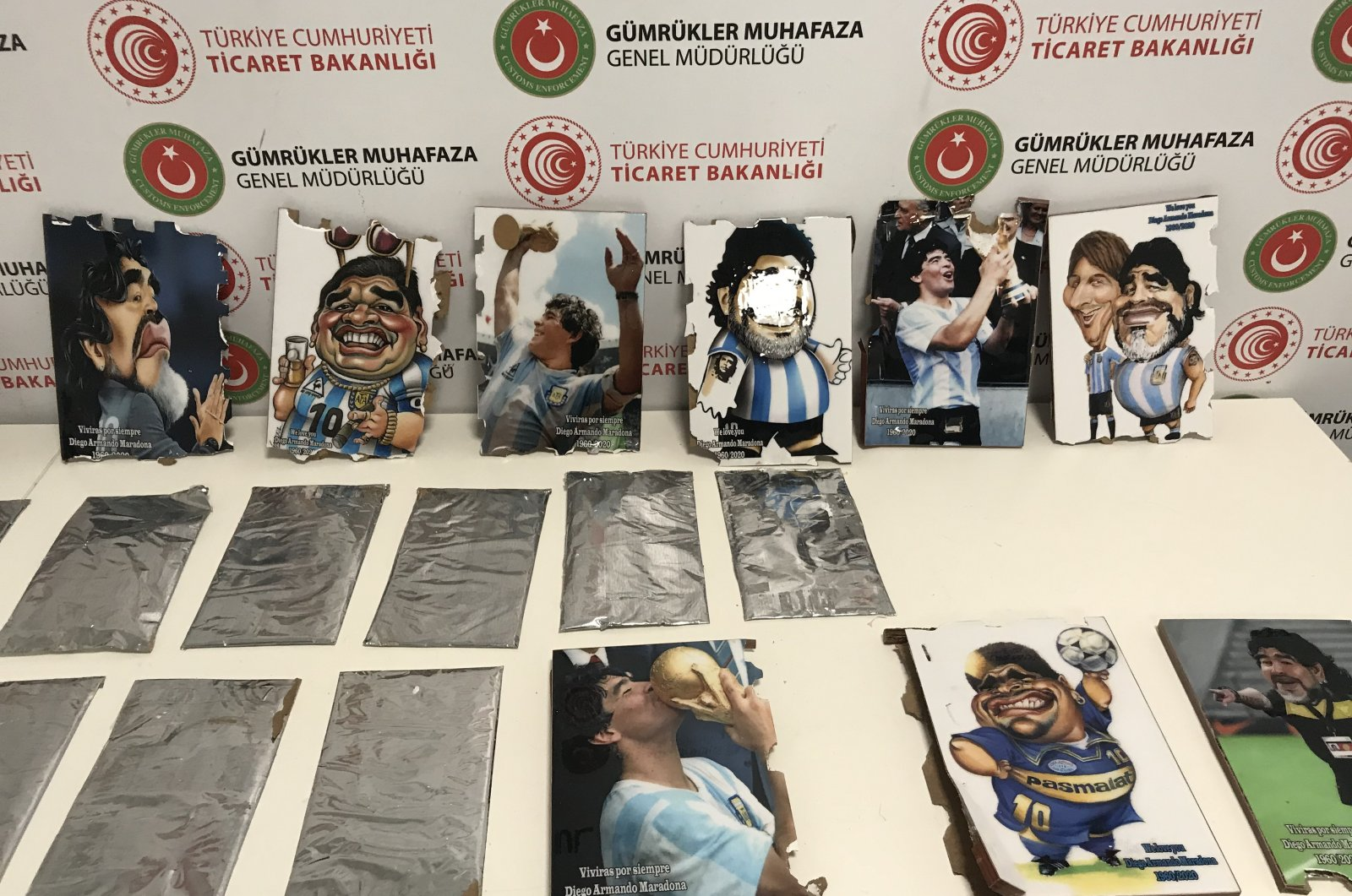 A view of paintings next to plates of cocaine at Istanbul Airport, in Istanbul, Turkey, Dec. 23, 2020. (AA PHOTO)