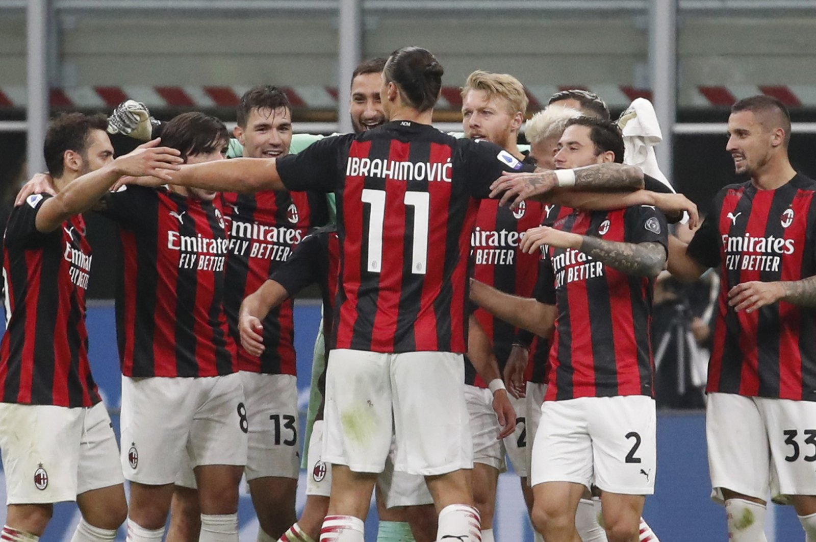 AC Milan's Zlatan Ibrahimovic embraces his teammates at the end of a Serie A match against Inter Milan at the San Siro Stadium, in Milan, Italy, Oct. 17, 2020. (AP Photo)