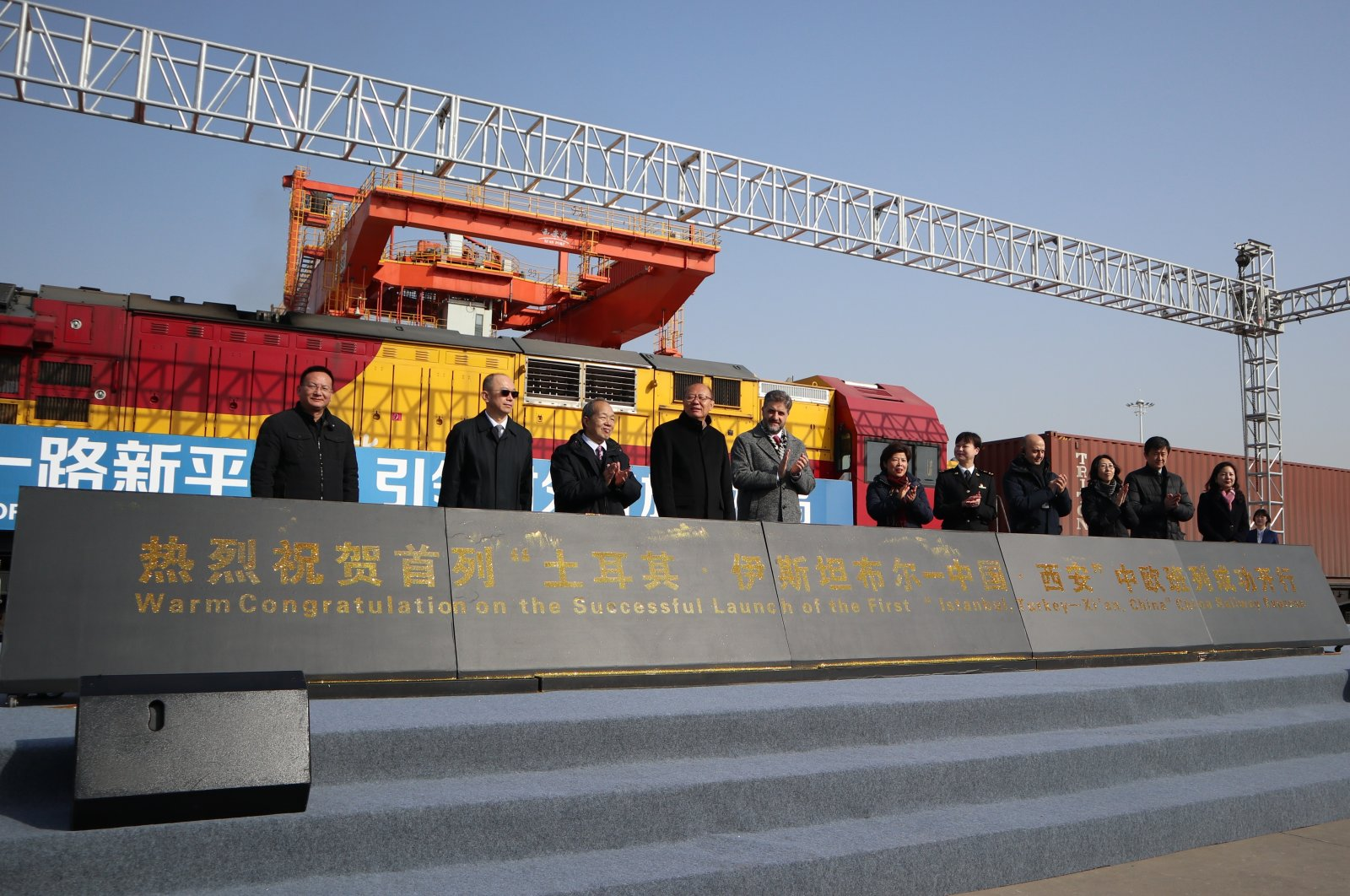 Turkish and Chinese officials on stage during the welcoming ceremony for the first Turkish freight train to arrive in Xi'an, the capital city of Shaanxi province in central China, Dec. 23, 2020. (IHA Photo)