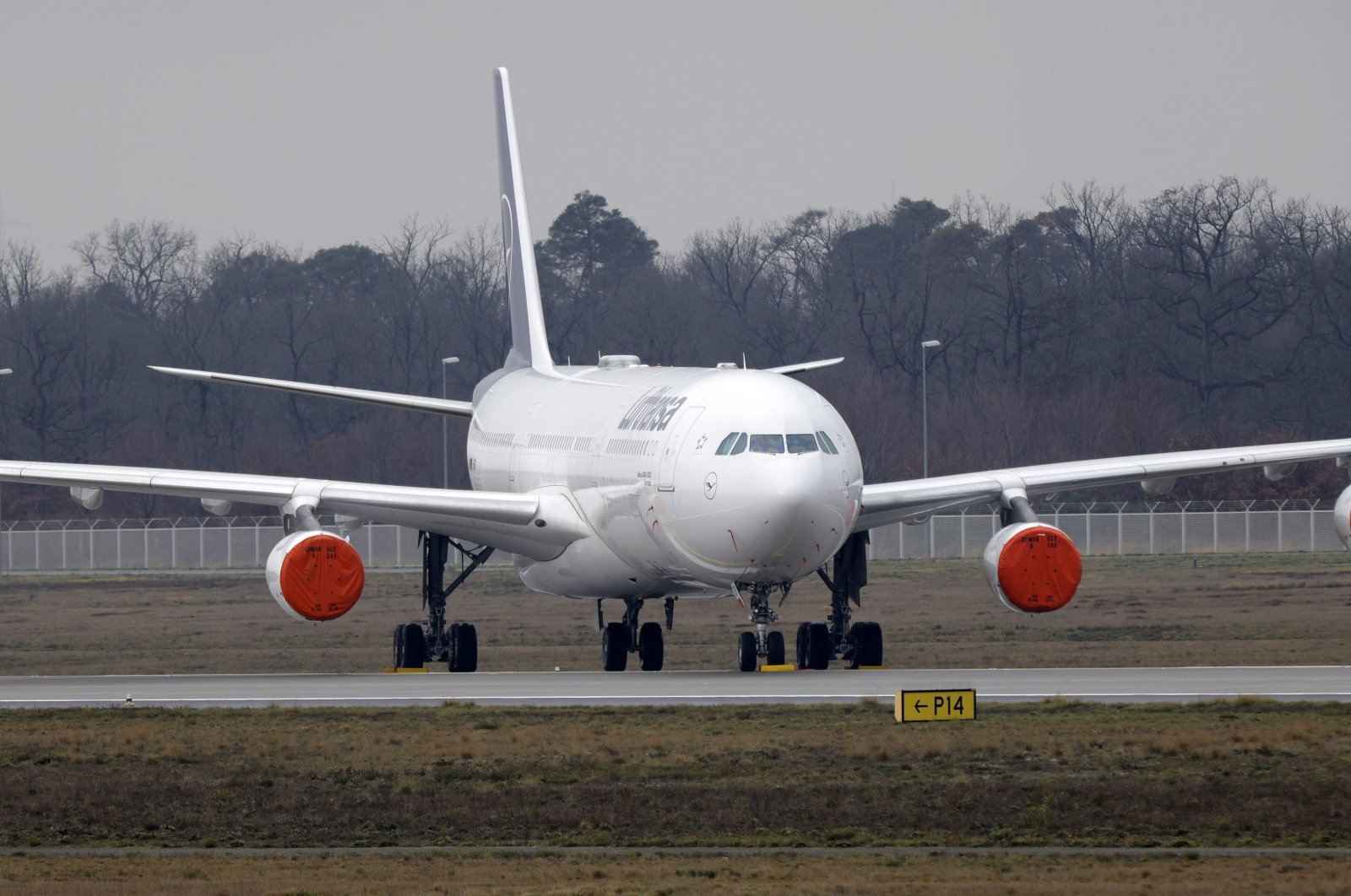 """An Airbus A320-300 aircraft """"Dorsten"""" of German flag carrier Lufthansa parks on a closed runway at the international airport in Frankfurt am Main, Germany, Dec. 21, 2020. (EPA Photo)"""