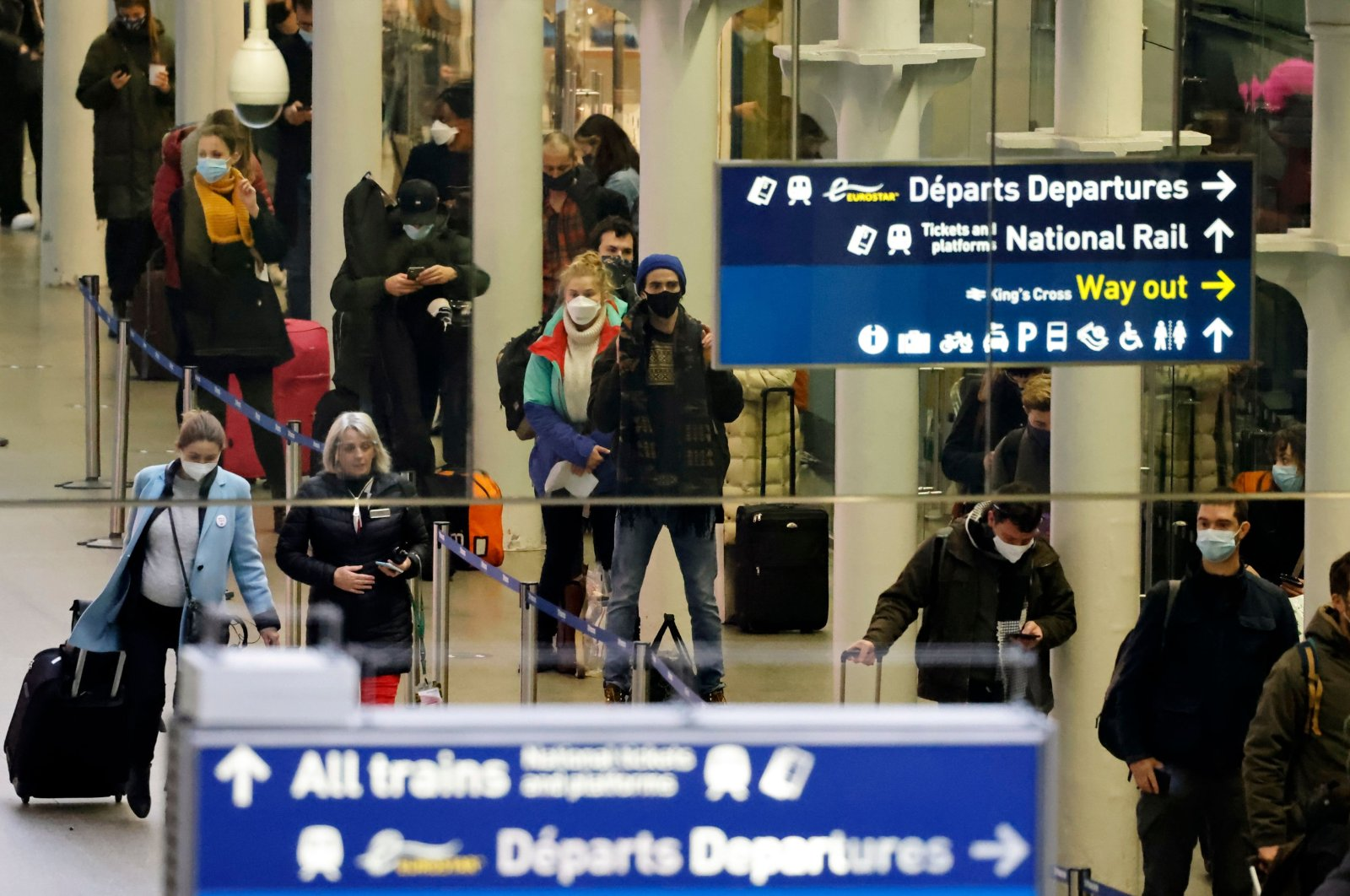 Passengers arrive at the Eurostar International Departures hall at St Pancras International station as services prepare to resume following a 48-hour closure of the French border due to a new coronavirus strain discovered in the U.K., in London, Britain, Dec. 23, 2020. (AFP Photo)