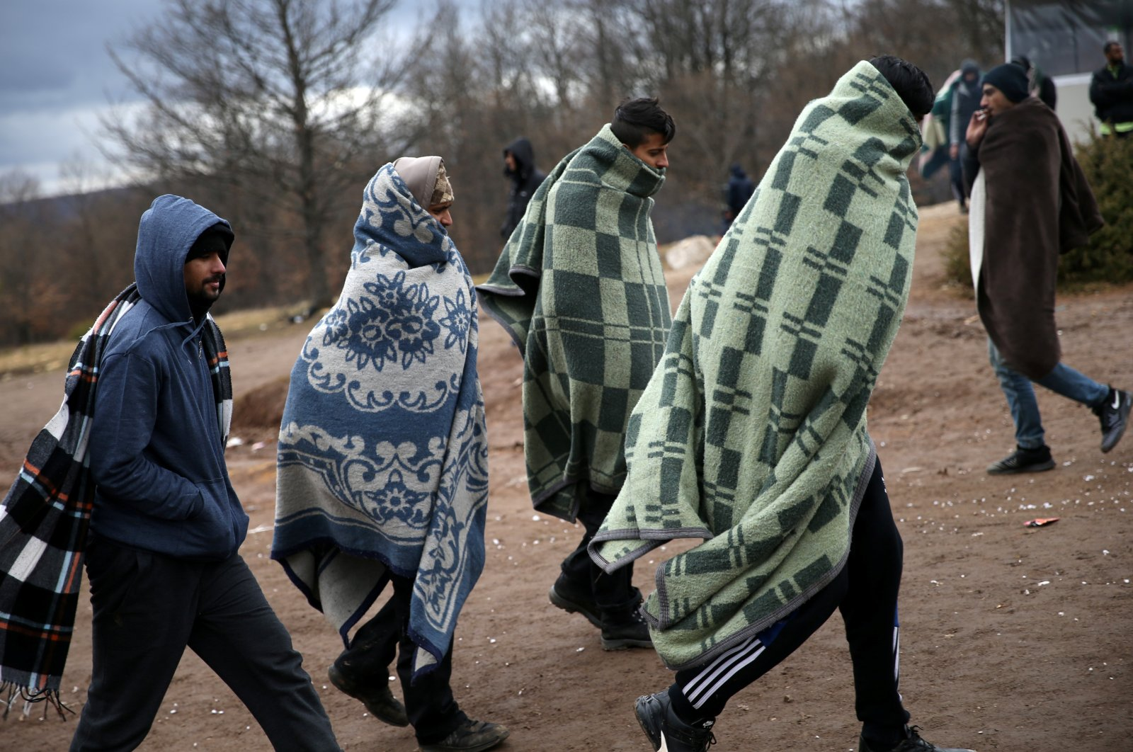 Migrants leave the Lipa center following a fire in Bihac, Bosnia-Herzegovina, Dec. 24, 2020. (Reuters Photo)