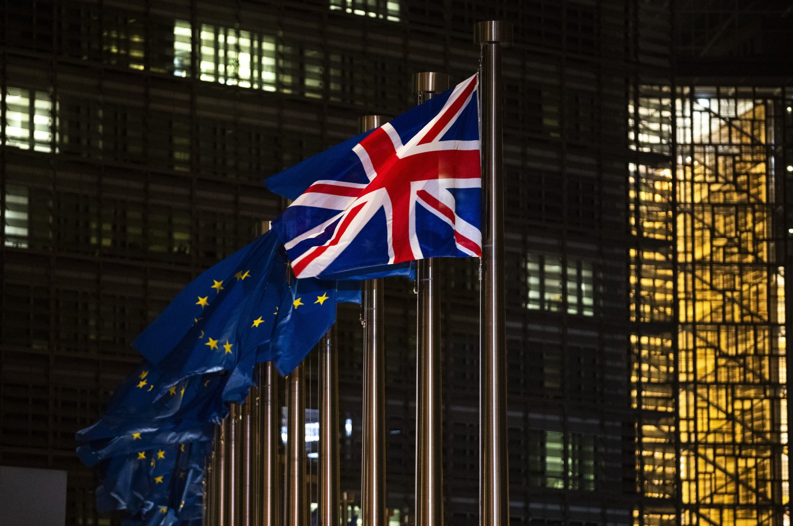 Flags of Britain and the European Union flap in the wind prior a meeting between European Commission President Ursula von der Leyen and British Prime Minister Boris Johnson at EU headquarters in Brussels, Belgium, Dec. 9, 2020. (AP Photo)