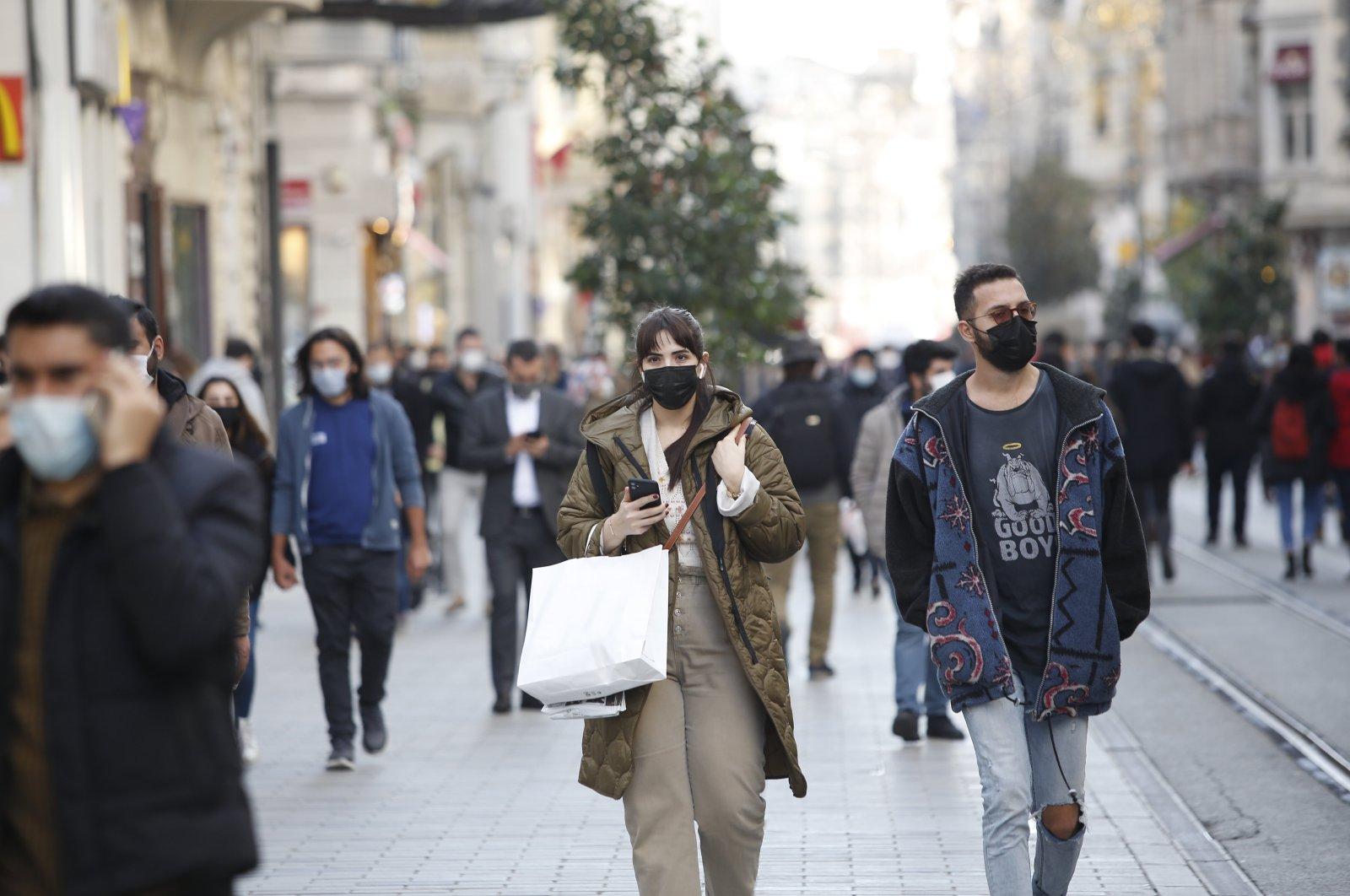 People walk in a popular shopping destination, İstiklal Avenue, in Istanbul, Turkey, Dec. 13, 2020. (Photo by Murat Şengül)