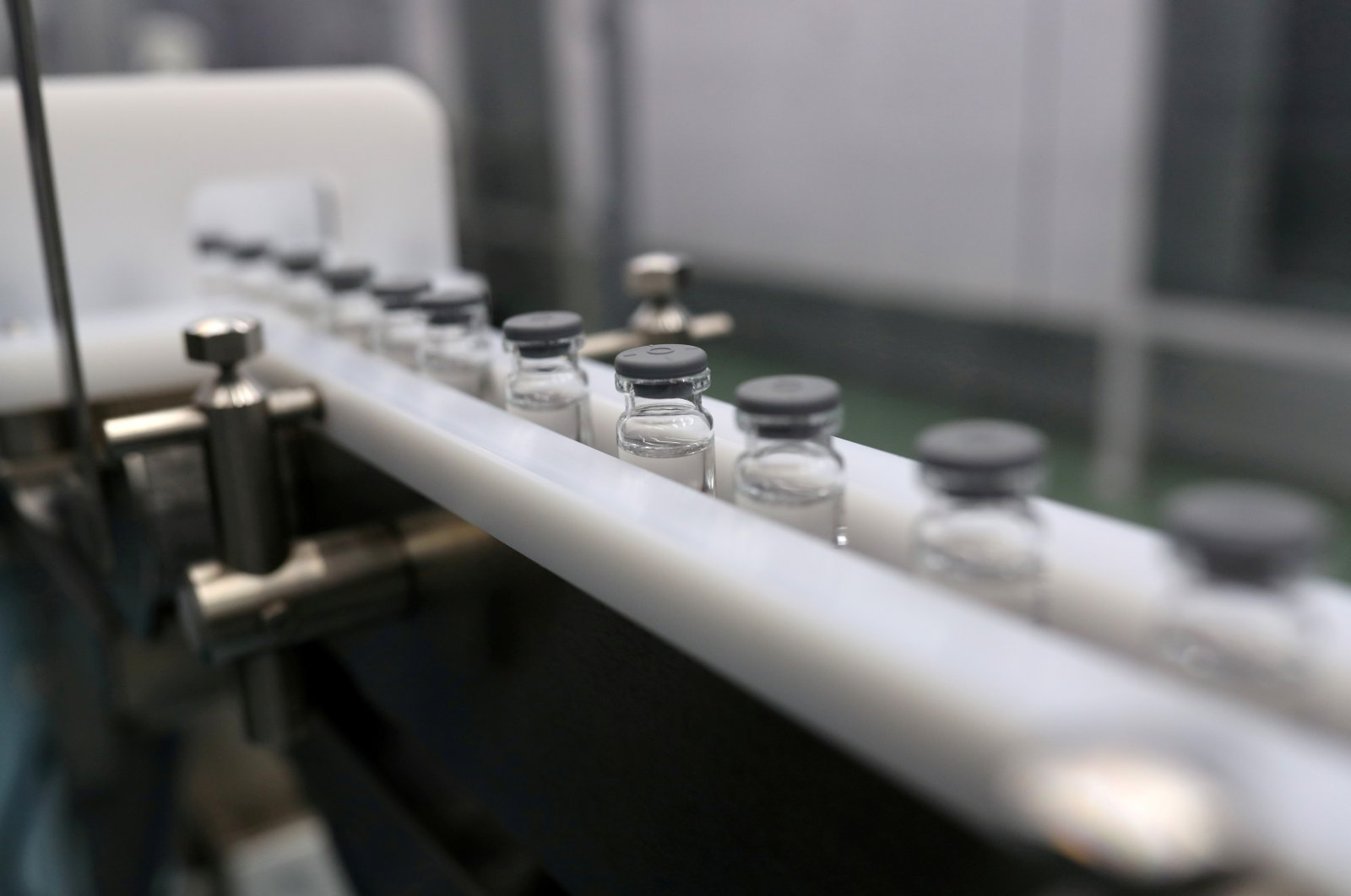 Glass bottles are seen at the bottling section where the Coronavac, Sinovac's vaccine against the coronavirus, will be produced at Brazil's biomedical center Butantan Institute in Sao Paulo, Brazil Dec. 22, 2020. (Reuters File Photo)