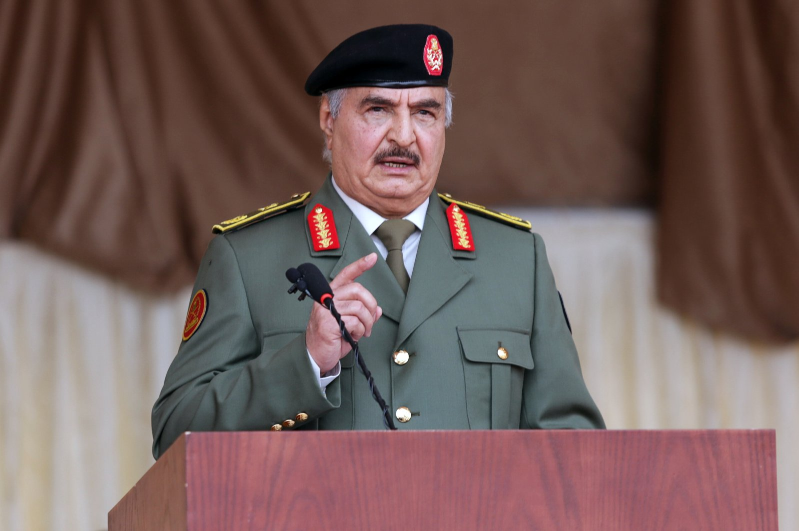 Libyan putschist Gen. Khalifa Haftar gestures as he speaks during Independence Day celebrations in Benghazi, Libya, Dec. 24, 2020. (Reuters Photo)