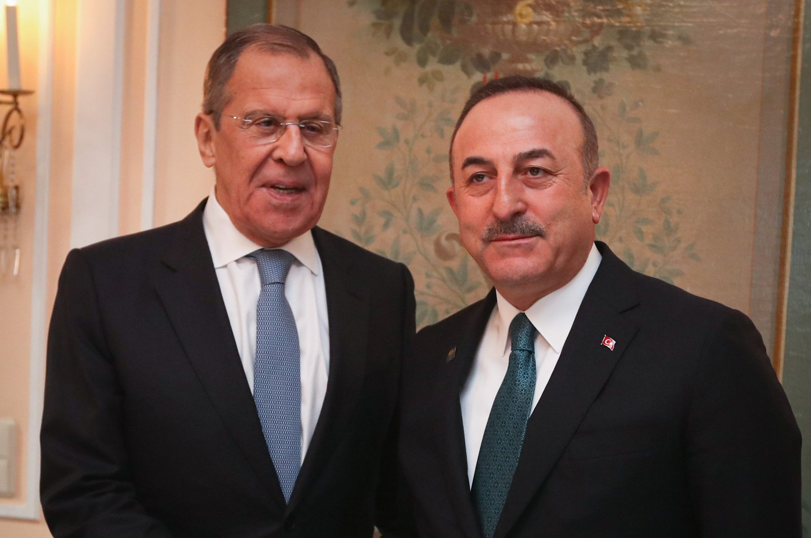 Russian Foreign Minister Sergey Lavrov (L) shakes hand with his Turkish counterpart, Mevlüt Çavuşoğlu, during the Munich Security Conference, Munich, Germany, Feb.17, 2020. (AA Photo)
