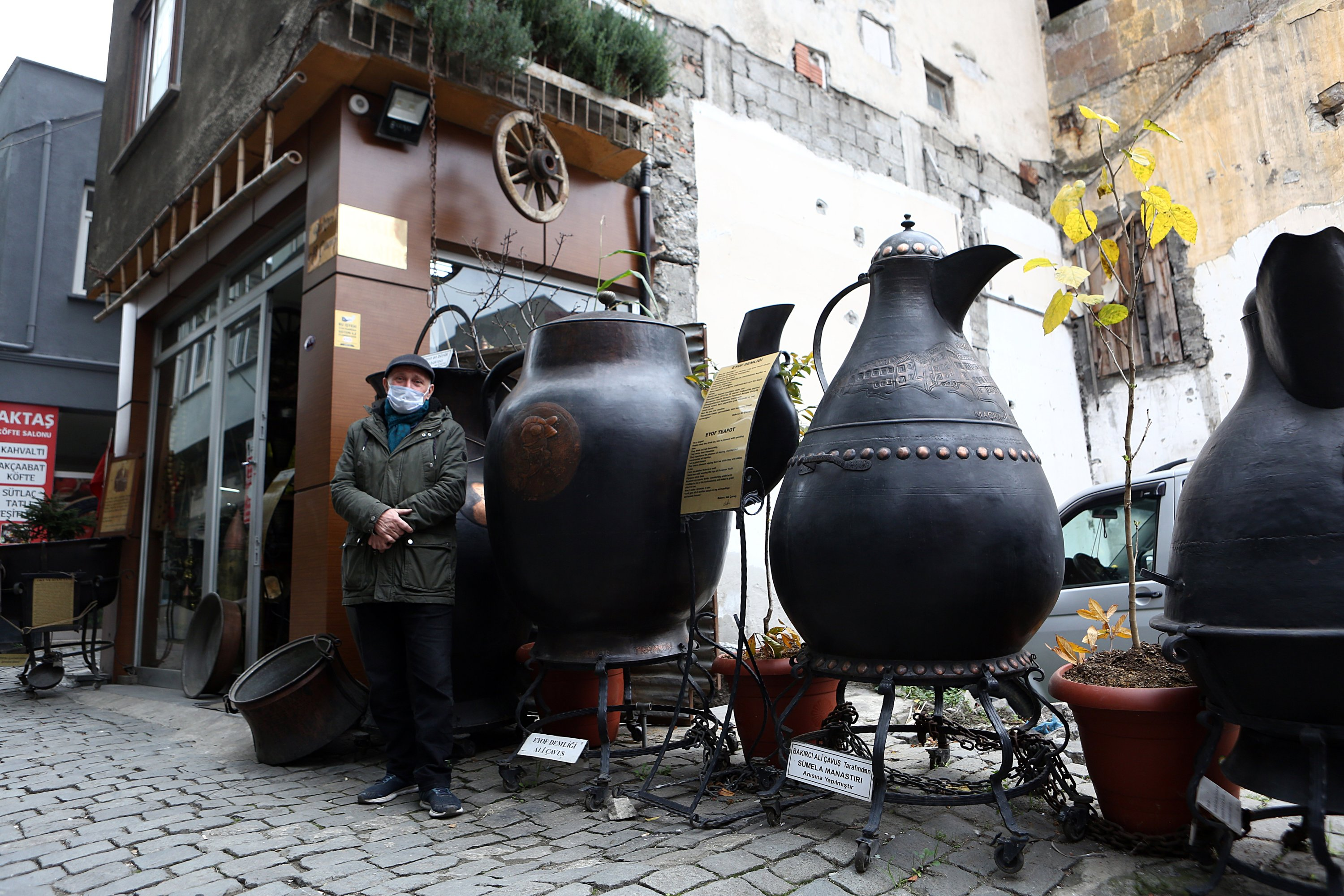 Ali Çavuş poses with his giant copperware in front of his workshop in Trabzon, northern Turkey, Dec. 24, 2020. (AA PHOTO)