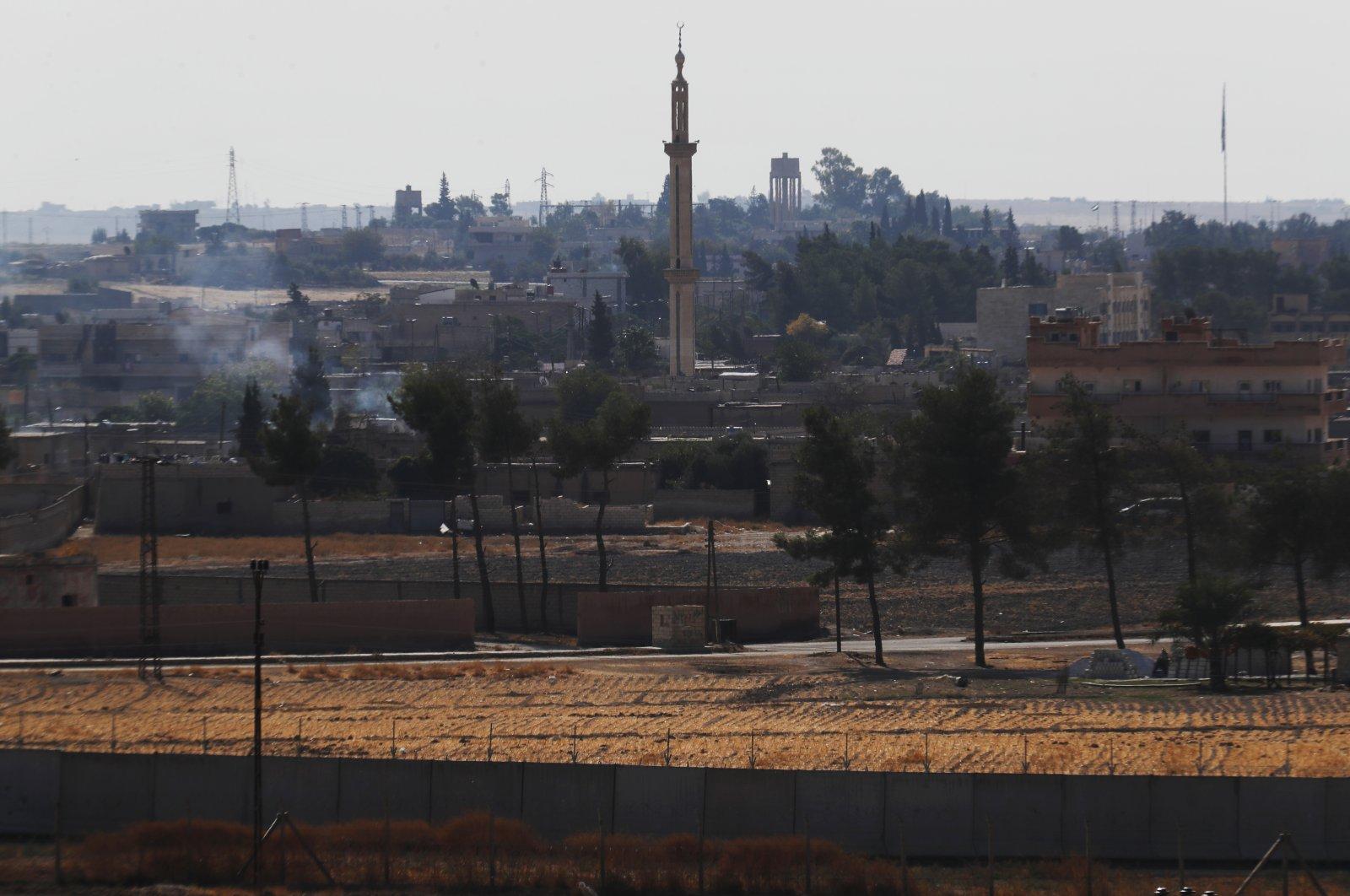The Syriantown of Tal Abyadis seen from theborder between Turkey and Syria, in Akçakale, Şanlıurfa province, southeastern Turkey, Oct. 23, 2019. (AP Photo)