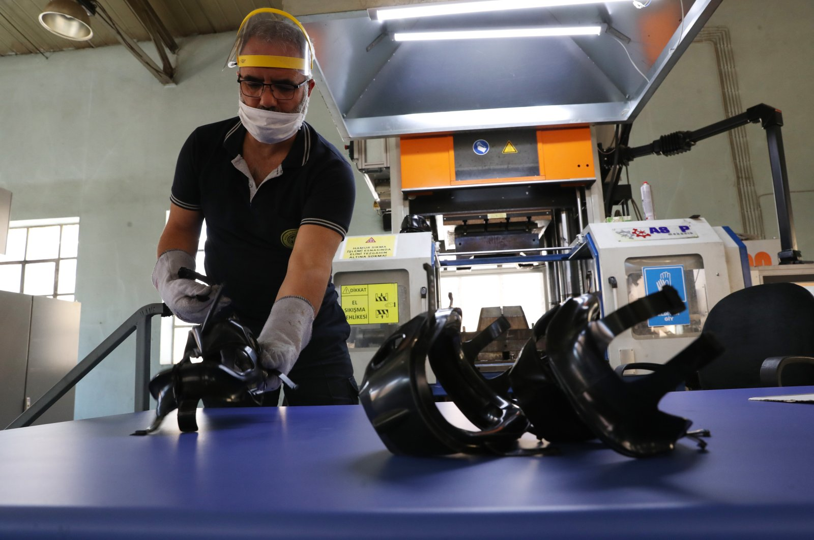 An employee assembles products in the Mechanical and Chemical Industry Corporation's (MKEK) Maksam Machine and Mask Factory in the capital Ankara, Turkey, May 15, 2020. (Sabah Photo)