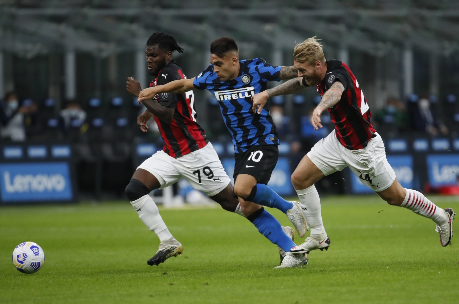 Inter Milan's Lautaro Martinez (C) is caught in between AC Milan's Franck Kessie (L) and Simon Kjaer during a Serie A at the San Siro Stadium, in Milan, Italy, Oct. 17, 2020. (AP Photo)
