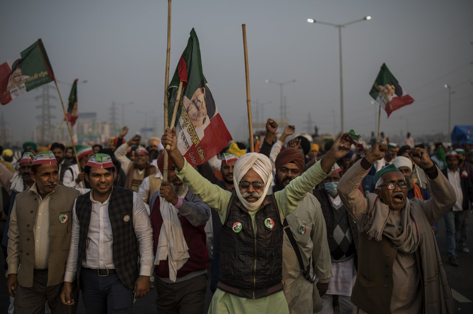 Indian farmers shout slogans as they block a major highway during a protest against new farm laws at the Delhi-Uttar Pradesh state border, India, Dec. 5, 2020. (AP Photo)