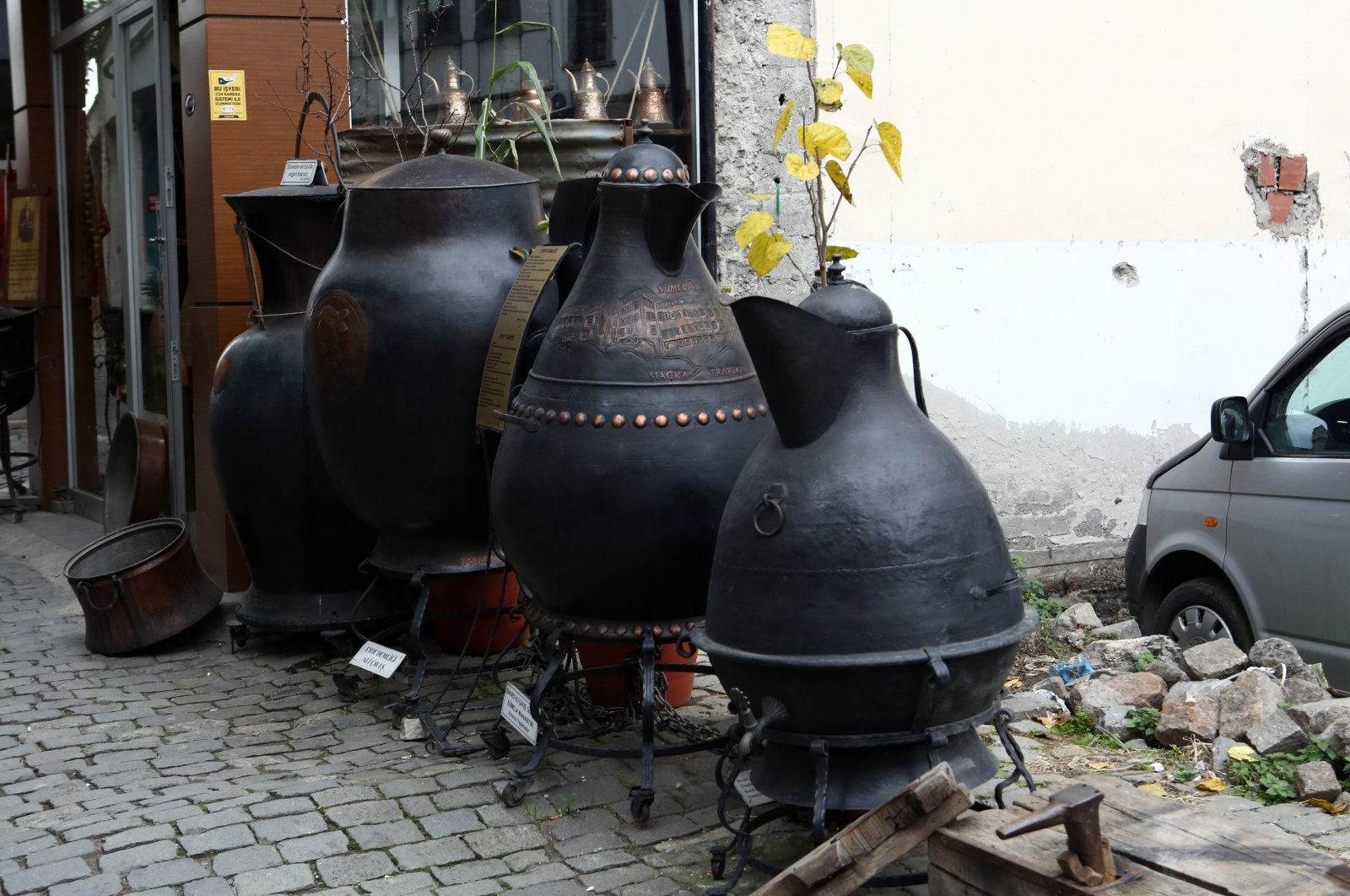 Giant copperware by Ali Çavuş is displayed in front of his workshop in Trabzon, northern Turkey, Dec. 24, 2020. (AA PHOTO)