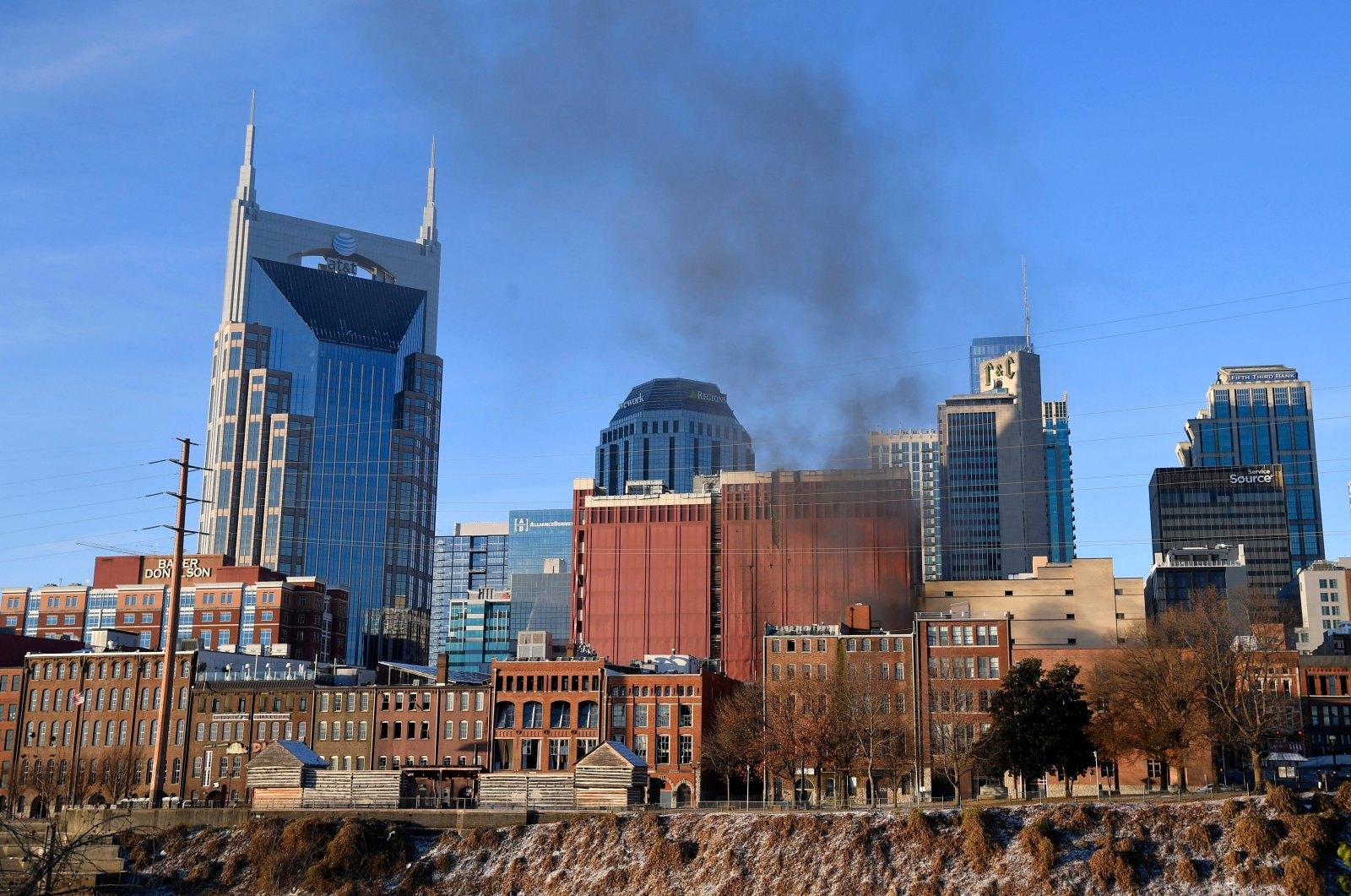 Smoke billows from the site of an explosion in the area of Second and Commerce in Nashville, Tennessee, U.S., Dec. 25, 2020. (Andrew Nelles/Tennessean.com/USA Today Network via Reuters)