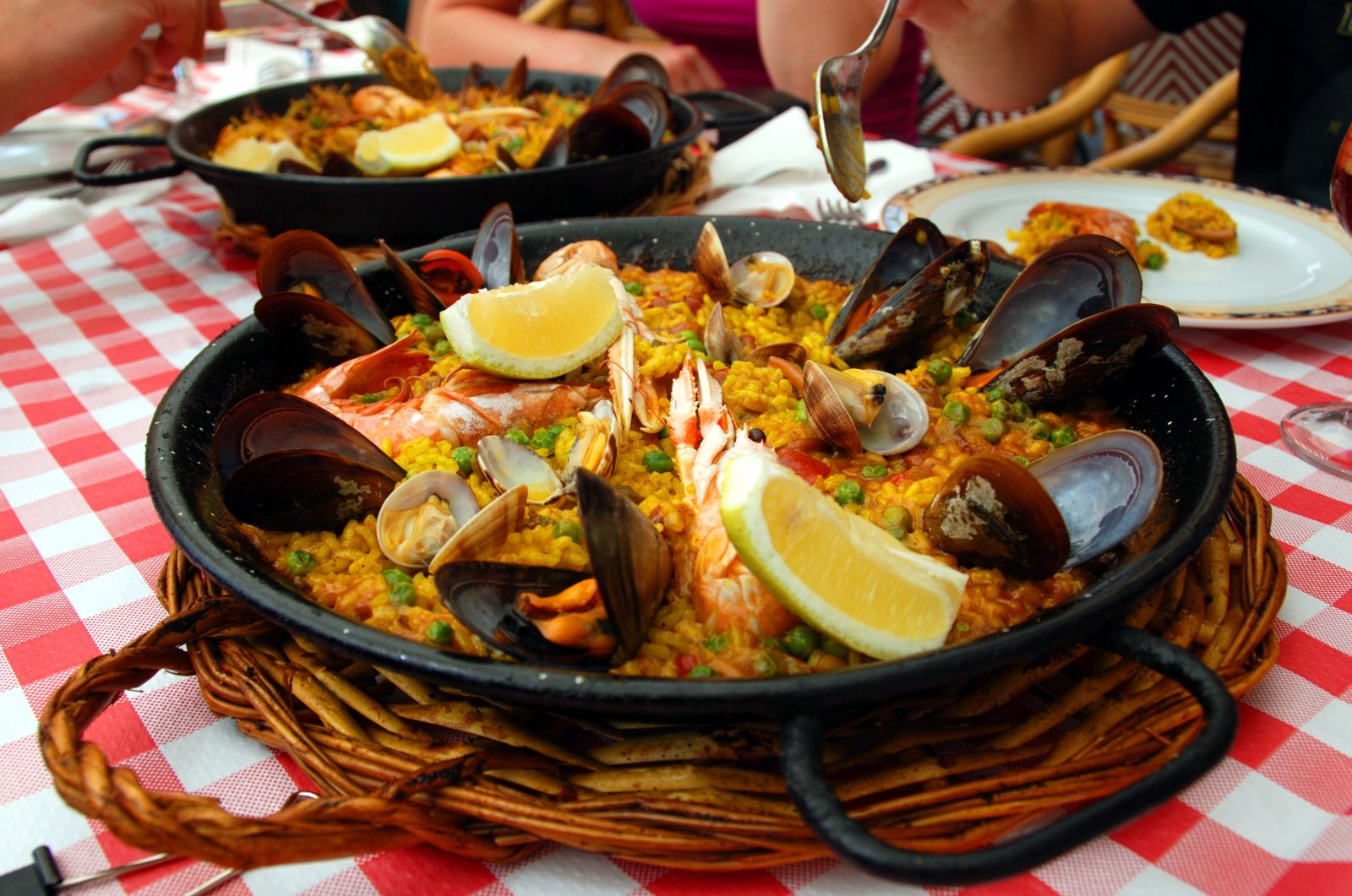 Spanish paella containing mussels with other seafood served in a pan. (iStock photo)