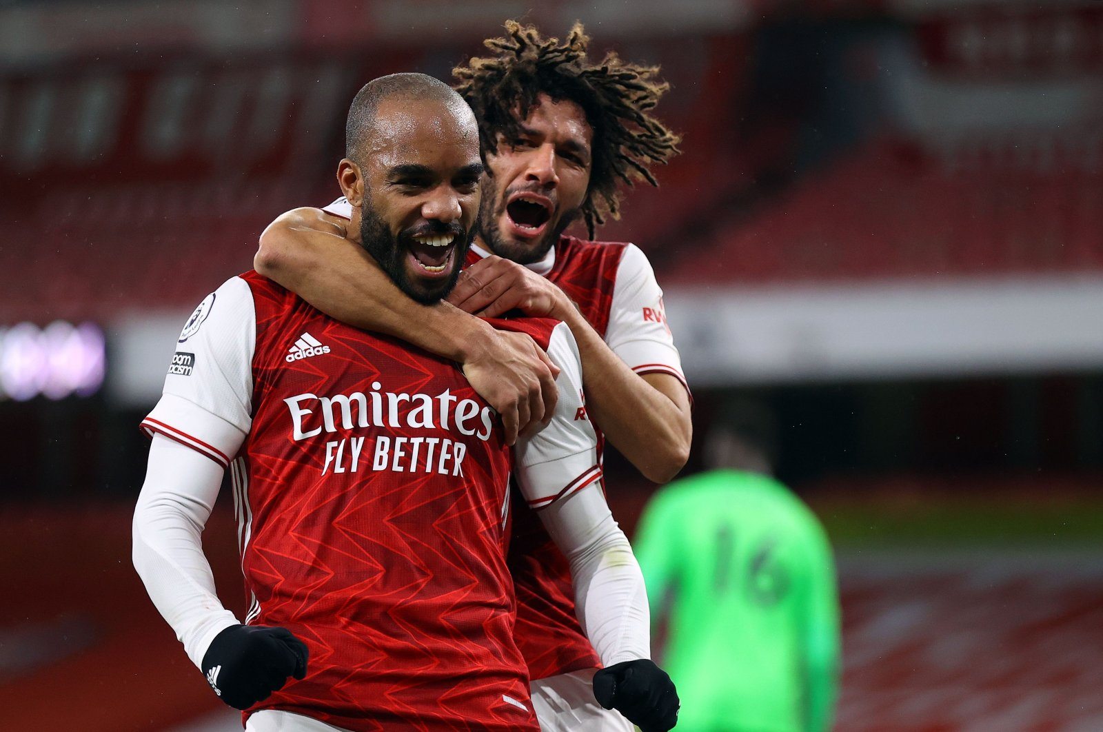 Arsenal's Alexandre Lacazette (L) and Mohamed Elneny celebrate a goal during the Premier League match against Chelsea at the Emirates Stadium in London, Britain, Dec. 26, 2020. (AFP Photo)