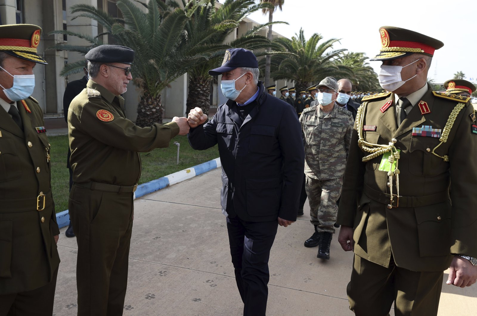 Turkey's Defense Minister Hulusi Aka (2nd R) and other top Turkish military commanders greet Libyan commanders, in Tripoli, Libya, Dec. 26, 2020. (AP Photo)