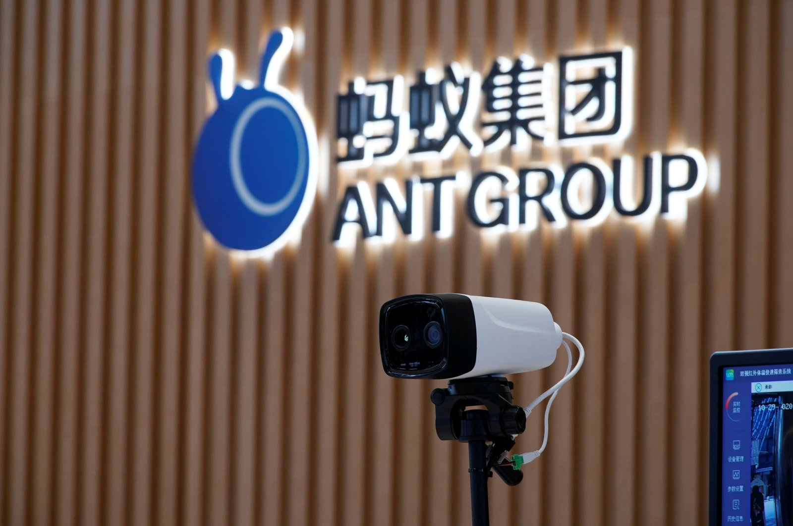 A thermal imaging camera stands in front of the Ant Group logo at its headquarters in Hangzhou, Zhejiang province, China, on Oct. 29, 2020. (Reuters Photo)