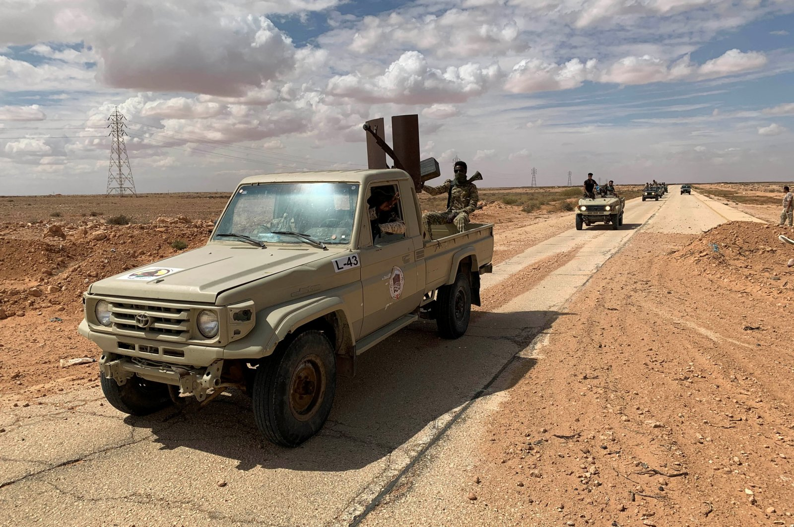 Troops loyal to Libya's internationally recognized government patrol the area in Zamzam, near Abu Qareen, Libya, Sept. 15, 2020. (REUTERS Photo)