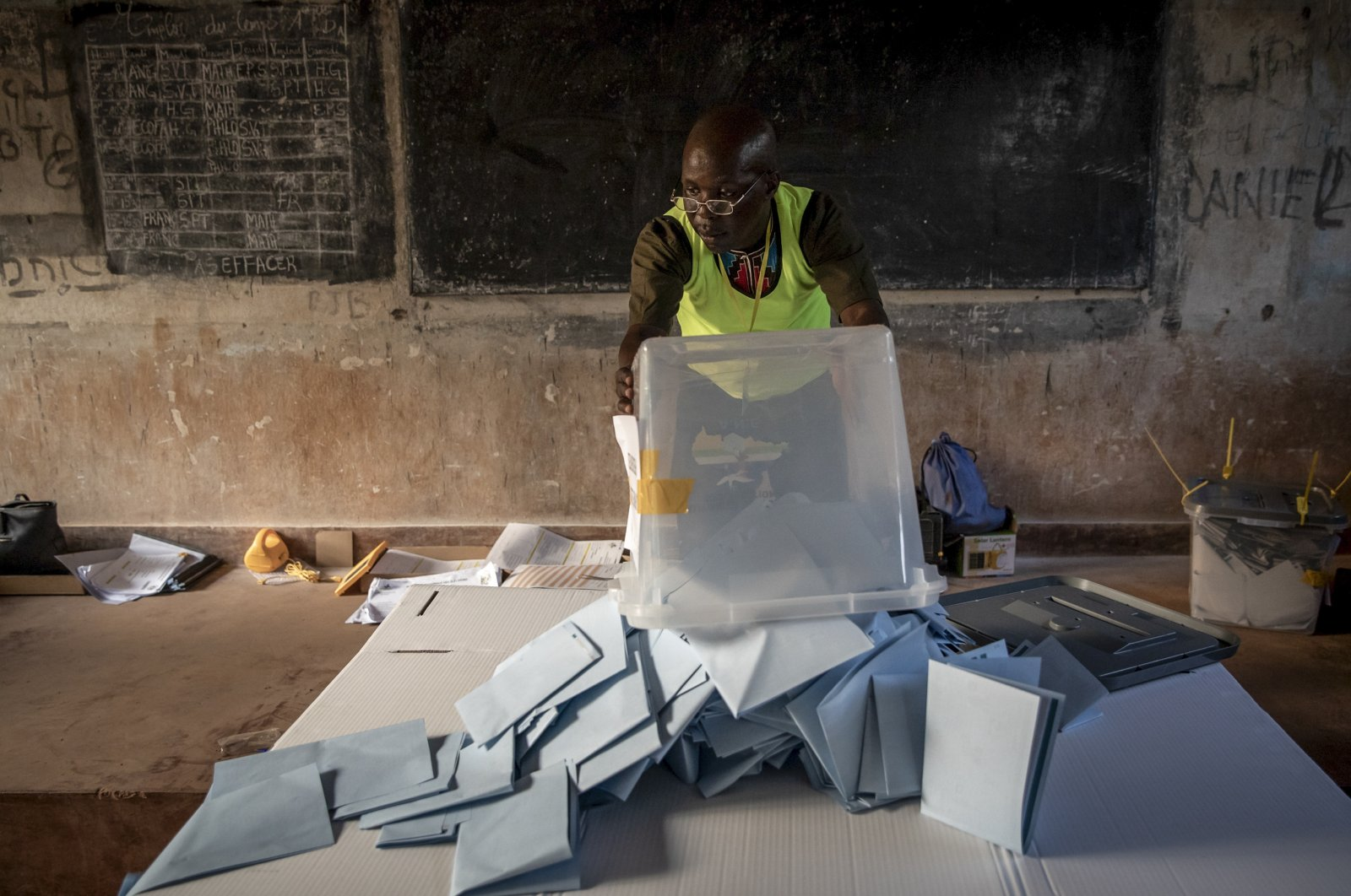 Electoral workers start to count votes at the Lycee Boganda polling station in the capital Bangui, Central African Republic Sunday, Dec. 27, 2020. (AP Photo)
