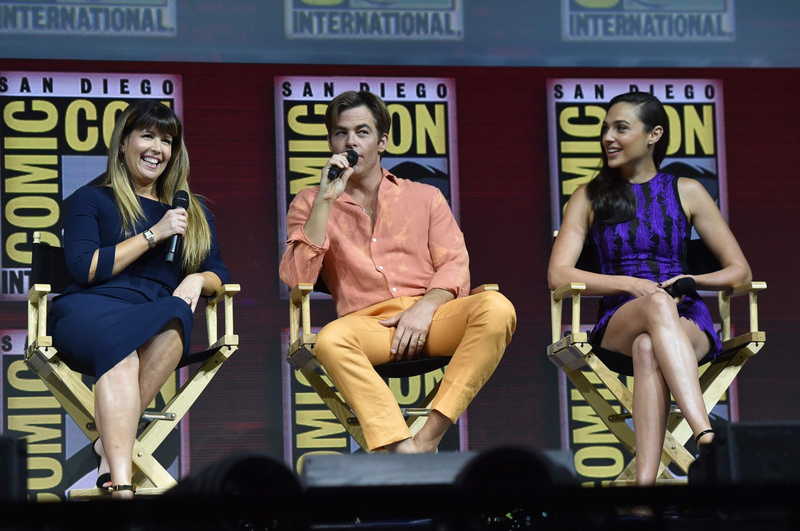 """Director Patty Jenkins, and actors Chris Pine and Gal Gadot (L-R) participate in the Warner Bros. Theatrical Panel for """"Wonder Woman 1984"""" during Comic Con in San Diego, July 21, 2018.  (AFP Photo)"""