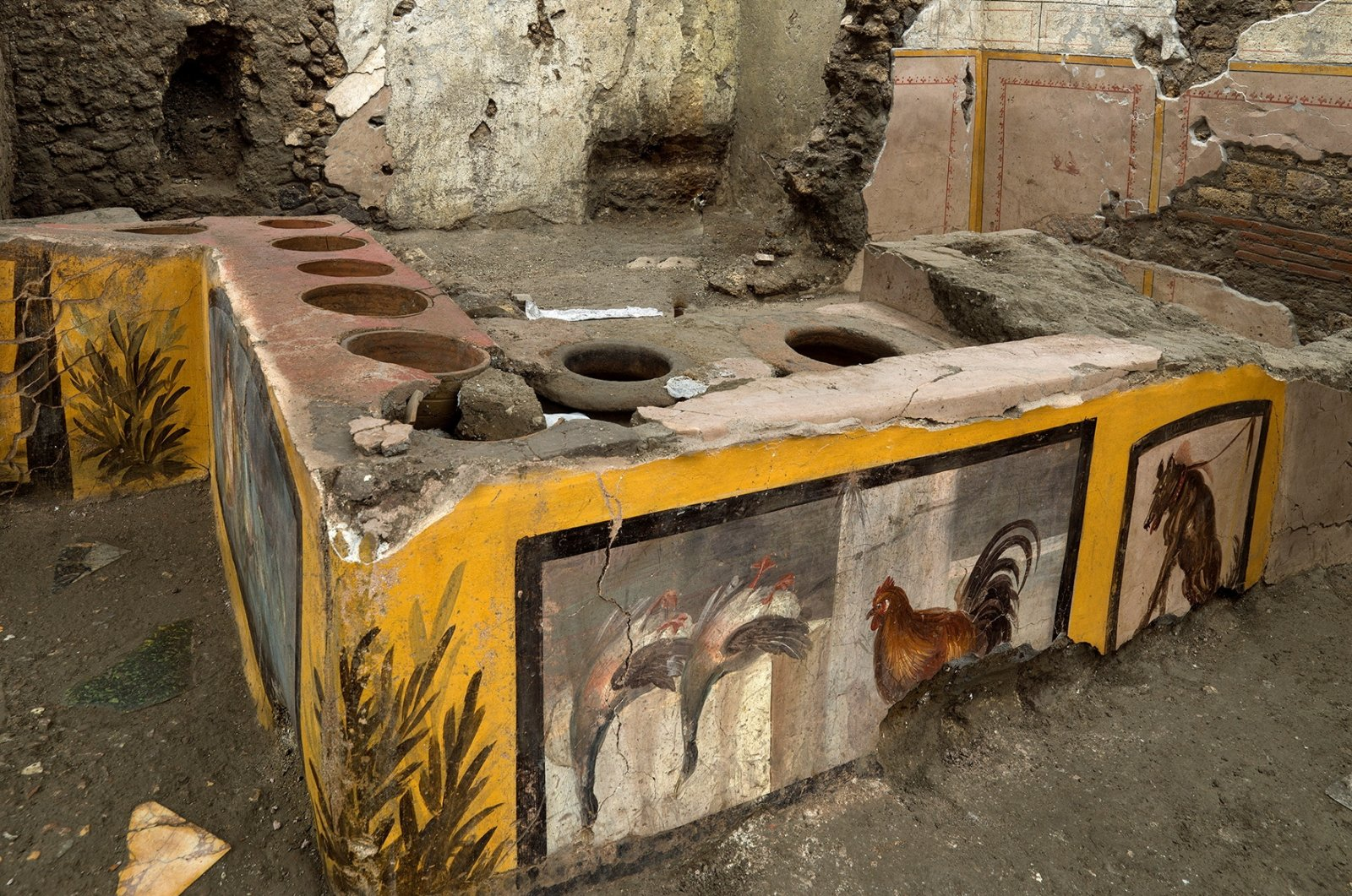 Frescoes on an ancient counter discovered during excavations in Pompeii, Italy, are seen in this handout picture released Dec. 26, 2020. (Pompeii Archaeological Park/Ministry of Cultural Heritage and Activities and Tourism via Reuters)
