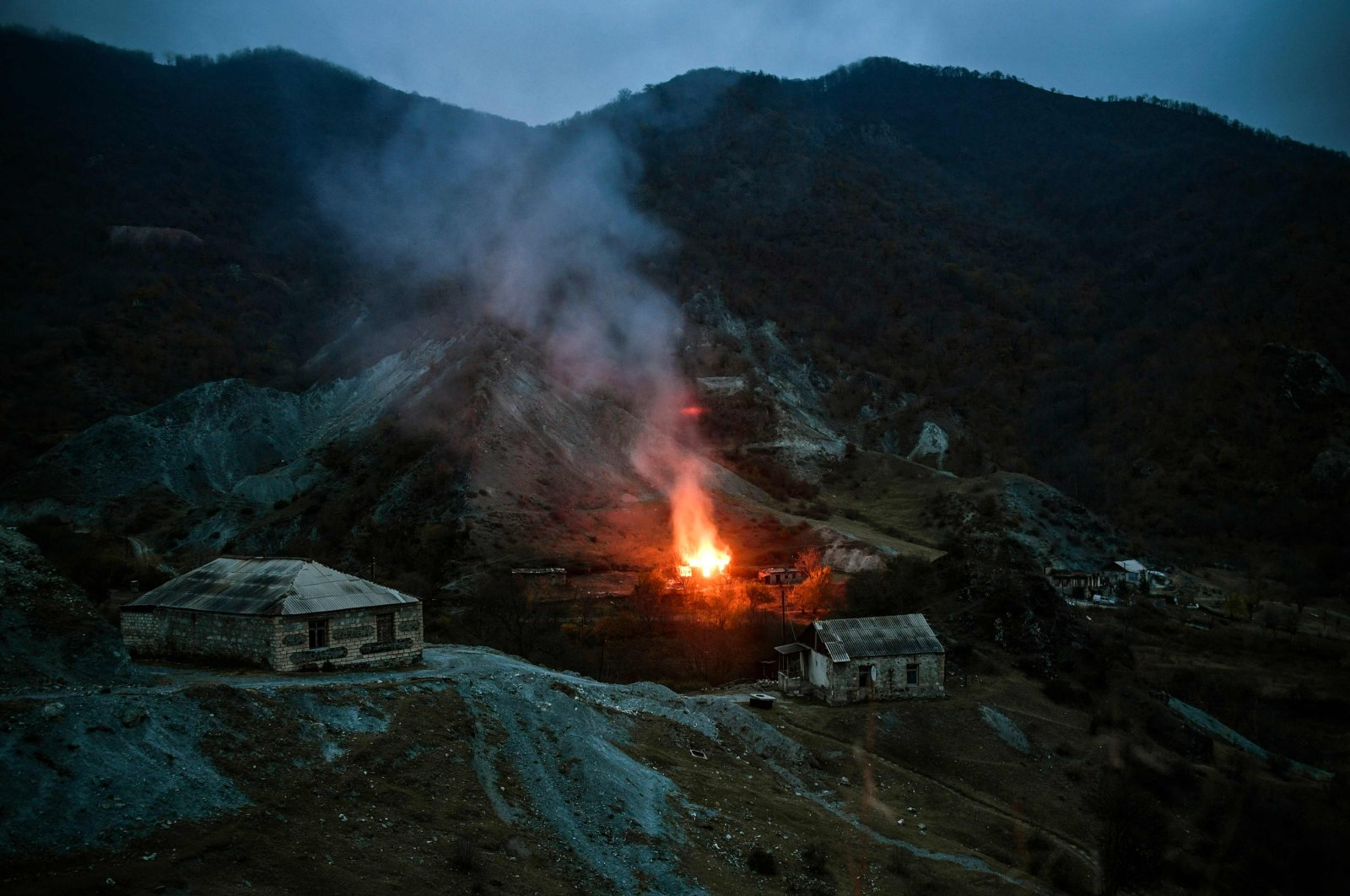 A house burns in a village outside the town of Kalbajar, after a peace agreement was signed to end the military conflict between Armenia and Azerbaijan over the disputed Nagorno-Karabakh region,  Nov. 14, 2020. (AFP Photo)