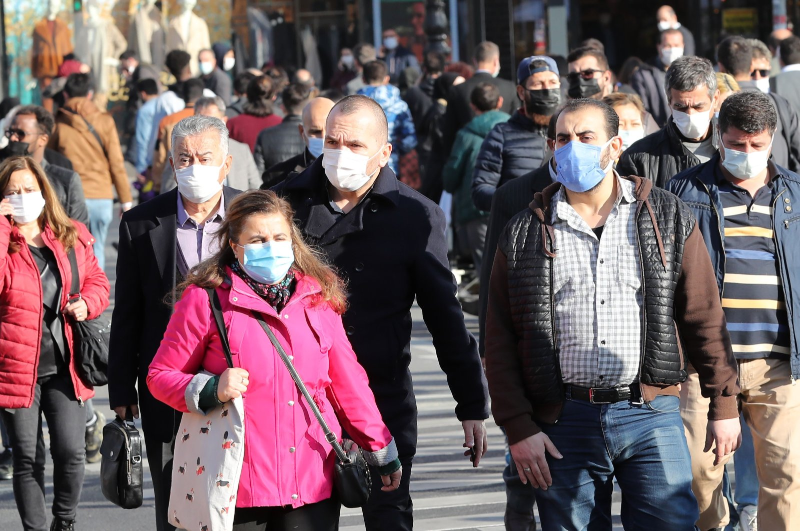 Pedestrians wearing masks walk in the capital Ankara, Turkey, Nov. 13, 2020. (AFP Photo)