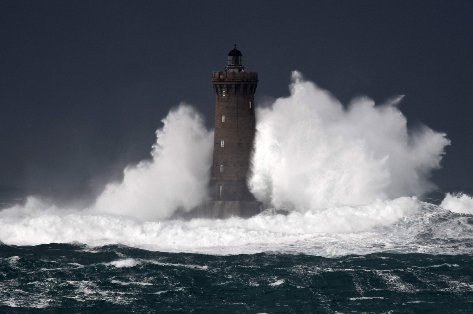 High waves and strong winds hit the Lighthouse of the Chenal du Four in Porspoder, western France, Dec. 27, 2020, as Storm Bella strikes the coast of Britanny. (AFP Photo)