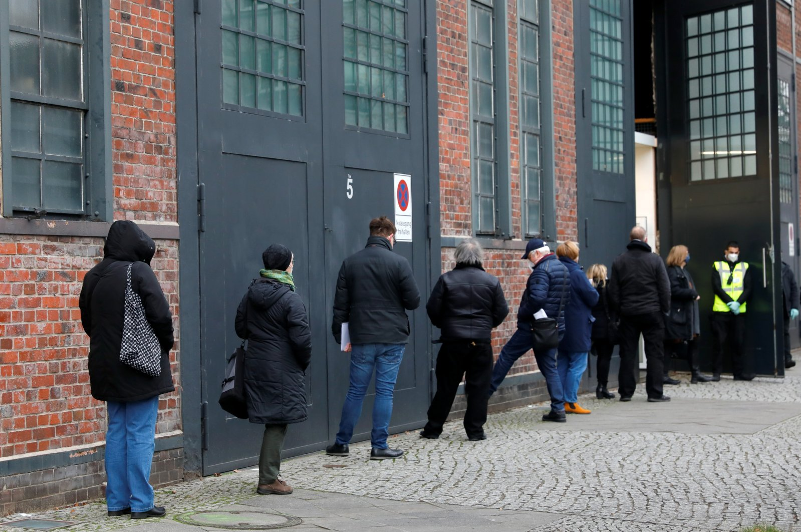 People queue to be vaccinated with the Pfizer-BioNTech COVID-19 vaccine at a COVID-19 vaccination center in Berlin, Germany, Dec. 26, 2020. REUTERS
