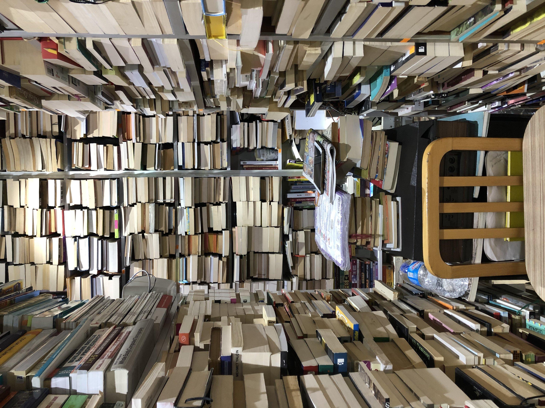 A narrow corridor between shelves in a bookstore in Sinanpaşa. (Photo by Matt Hanson)