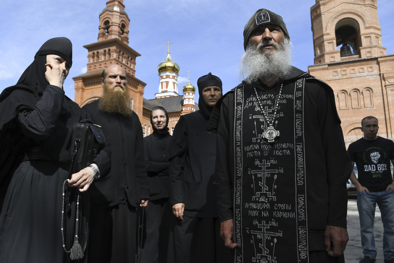 Russian police arrest coronavirus-denying monk