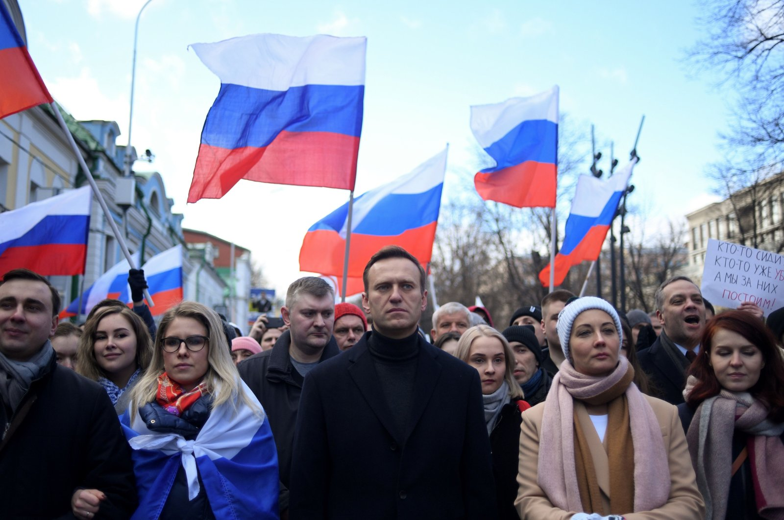 In this file photo, Russian opposition leader Alexei Navalny, his wife Yulia, opposition politician Lyubov Sobol and other demonstrators march in memory of murdered Kremlin critic Boris Nemtsov in downtown Moscow, Feb. 29, 2020. (AFP Photo)