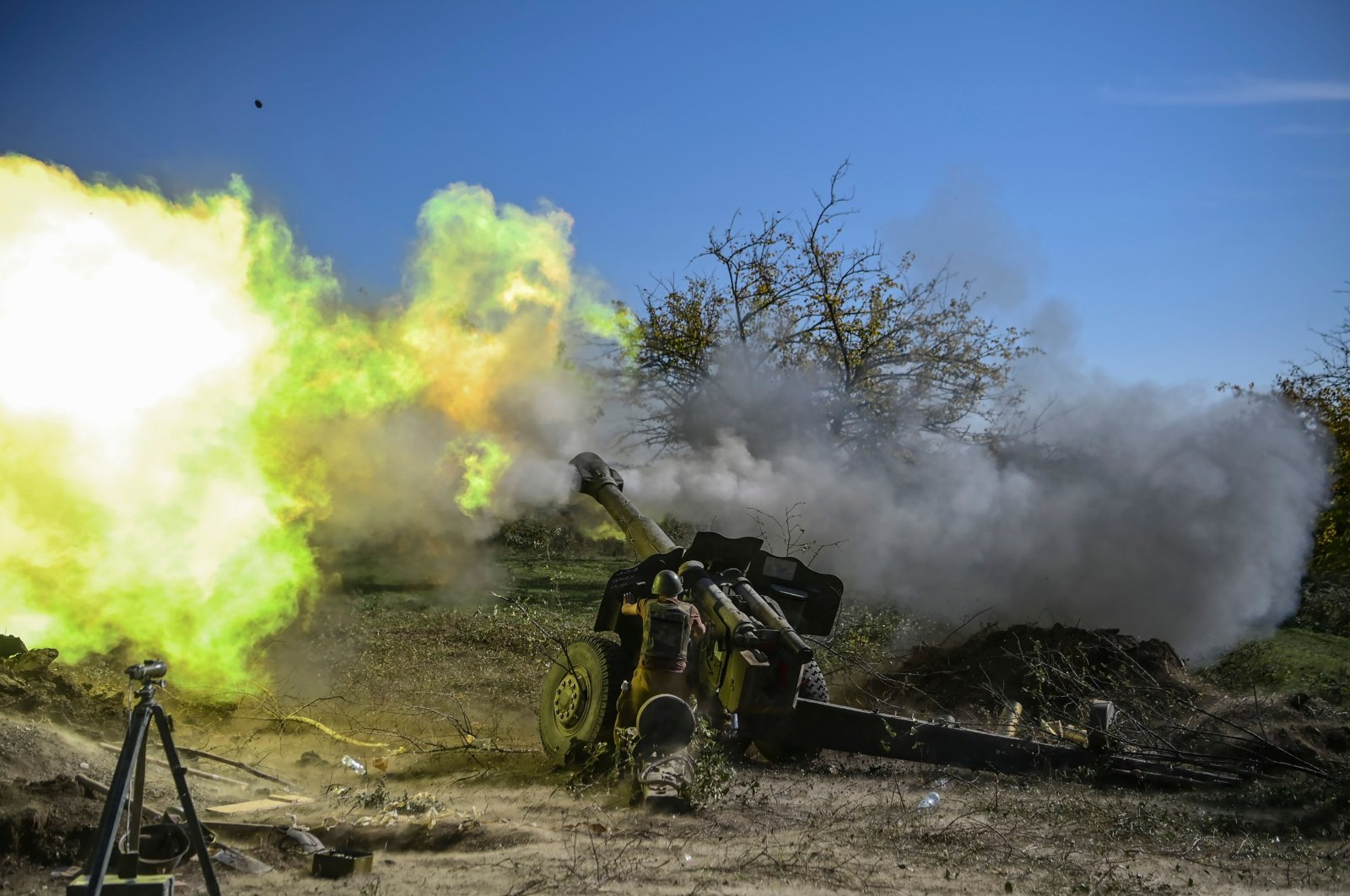 An Armenian soldier fires artillery on the front line during the ongoing fighting between Armenian and Azerbaijani forces over the region of Nagorno-Karabakh, Oct. 25, 2020. (AFP)