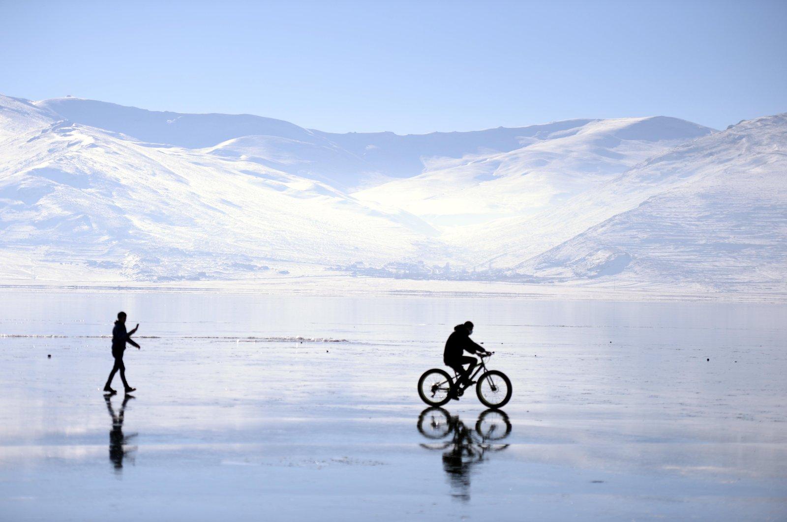 A man cycles on frozen Lake Çıldır in eastern Turkey. (AA Photo)