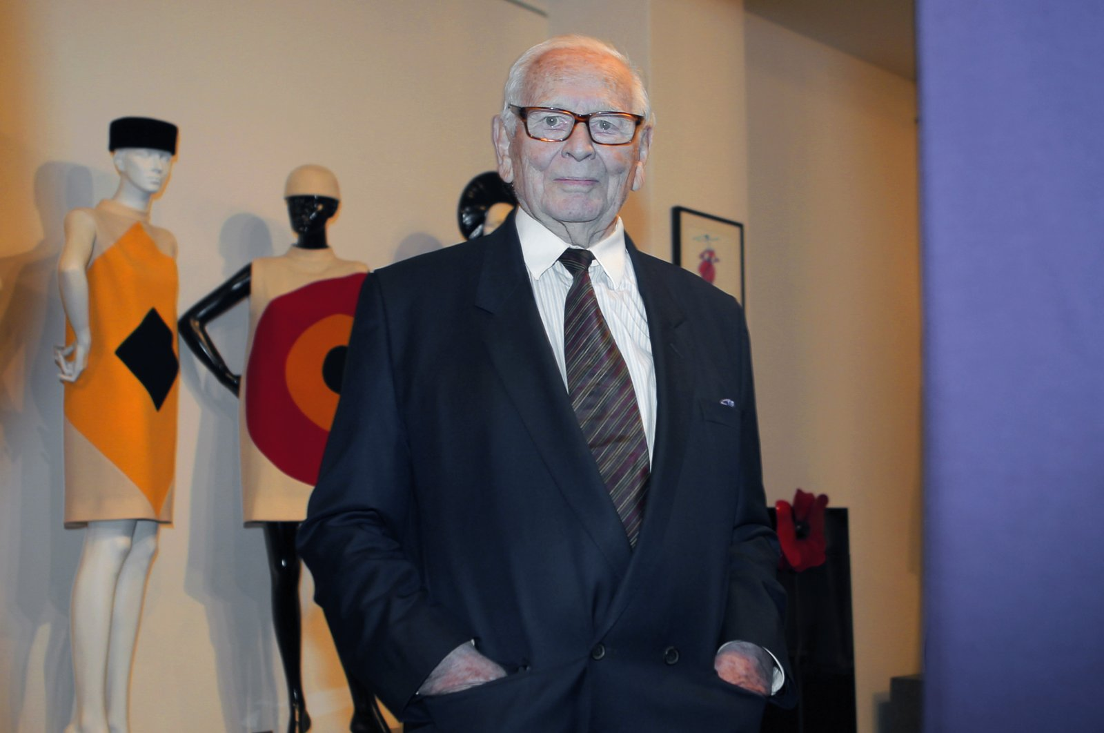 French fashion designer Pierre Cardin poses with a dress on a mannequin during the inauguration of the Pierre Cardin Museum in Paris, France, Nov. 13, 2014. (AP Photo)